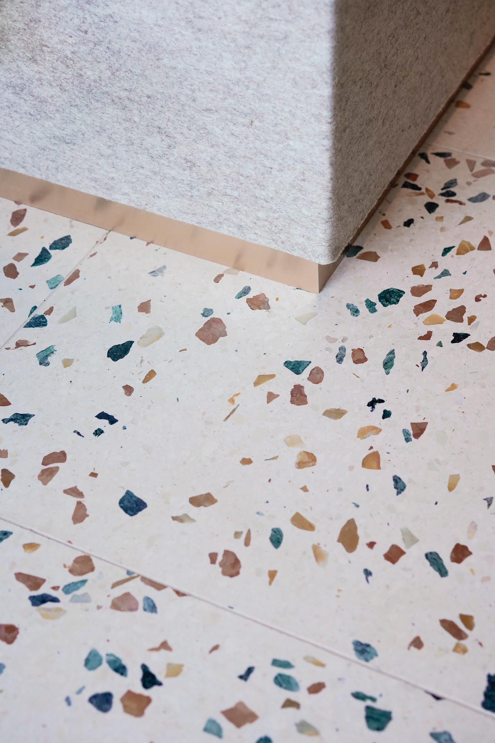 A modern interior with colorful terrazzo tile floors.