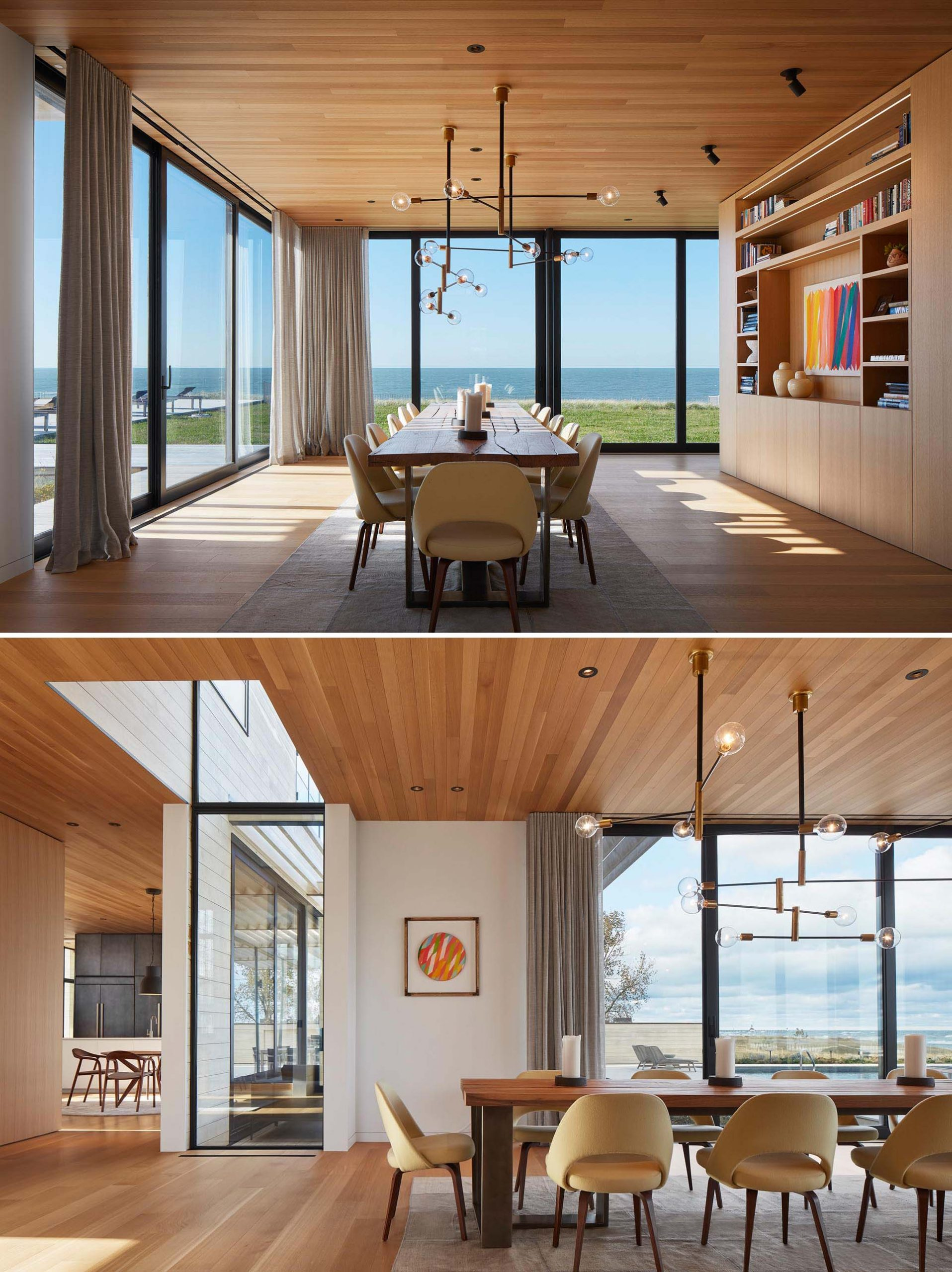 A modern living room with white oak floors and ceiling, and large windows that provide an unobstructed view of the lake.