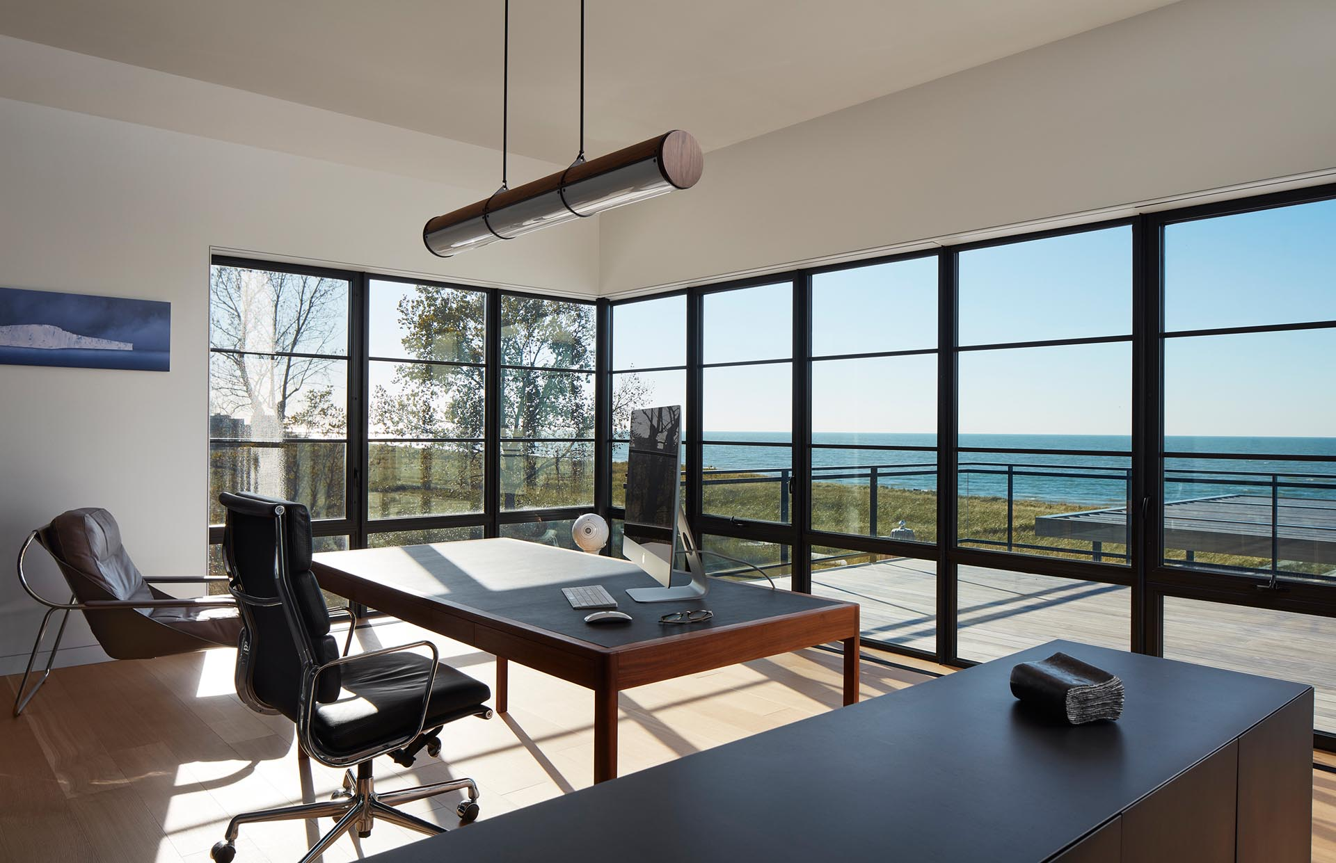 This home office is minimalist in its design, with a desk perfectly positioned for taking advantage of the views.