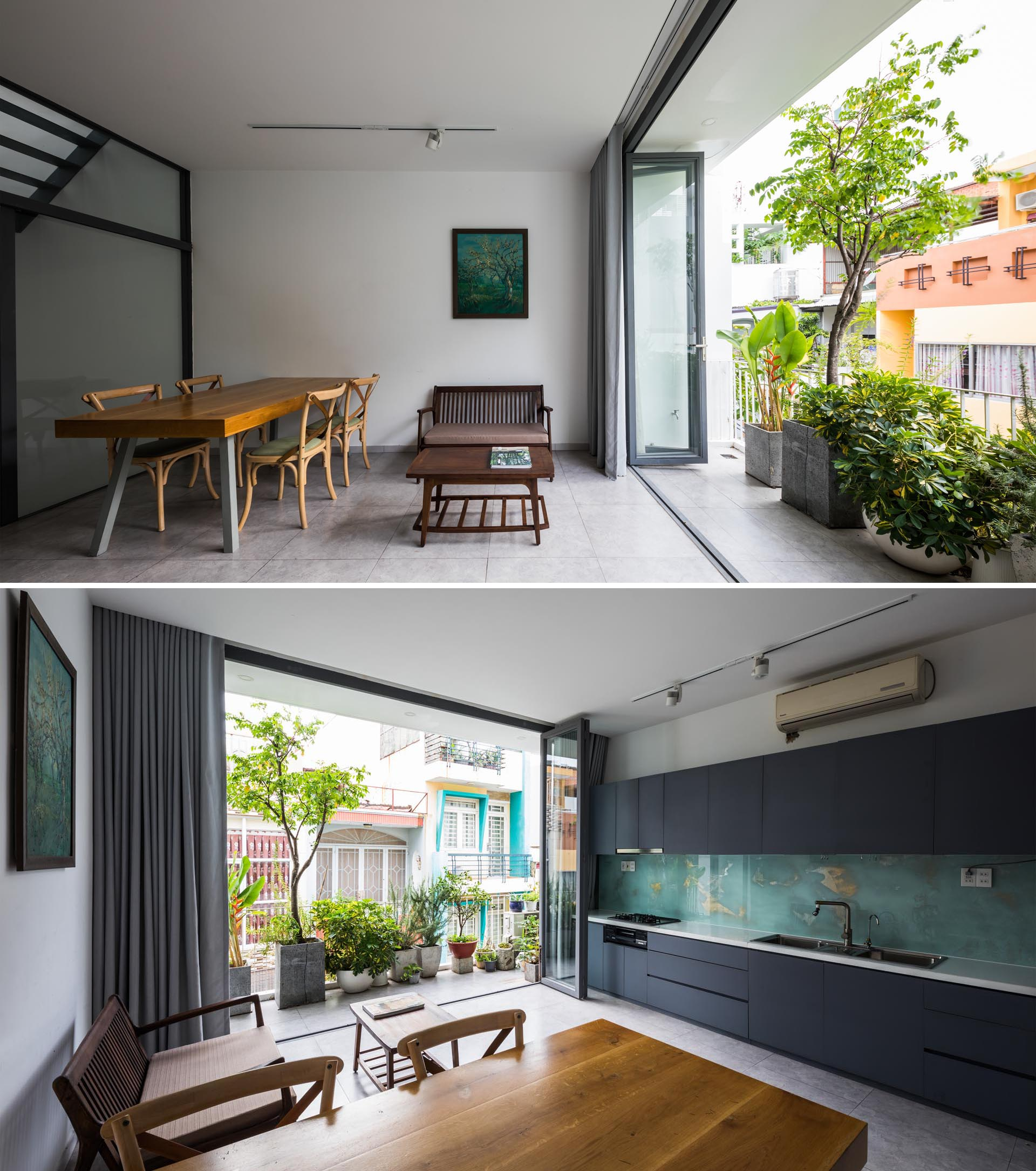 The second floor of this home includes the dining room, living room, and kitchen, all of which enjoy a balcony, where even more plants can be found.