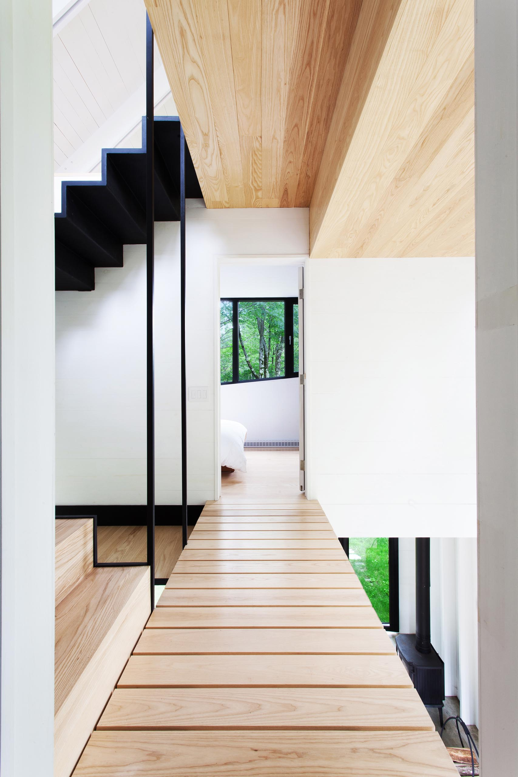 A small cottage with interior wood bridges / walkways.