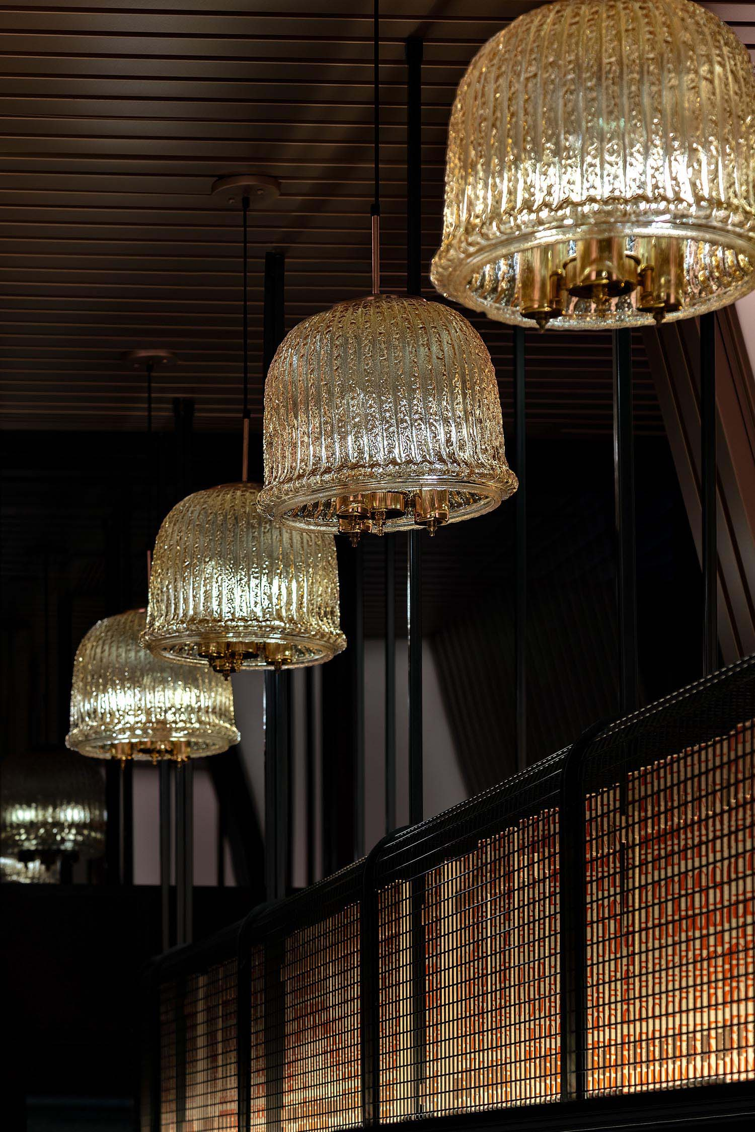 Glass pendant lights featured in a restaurant.