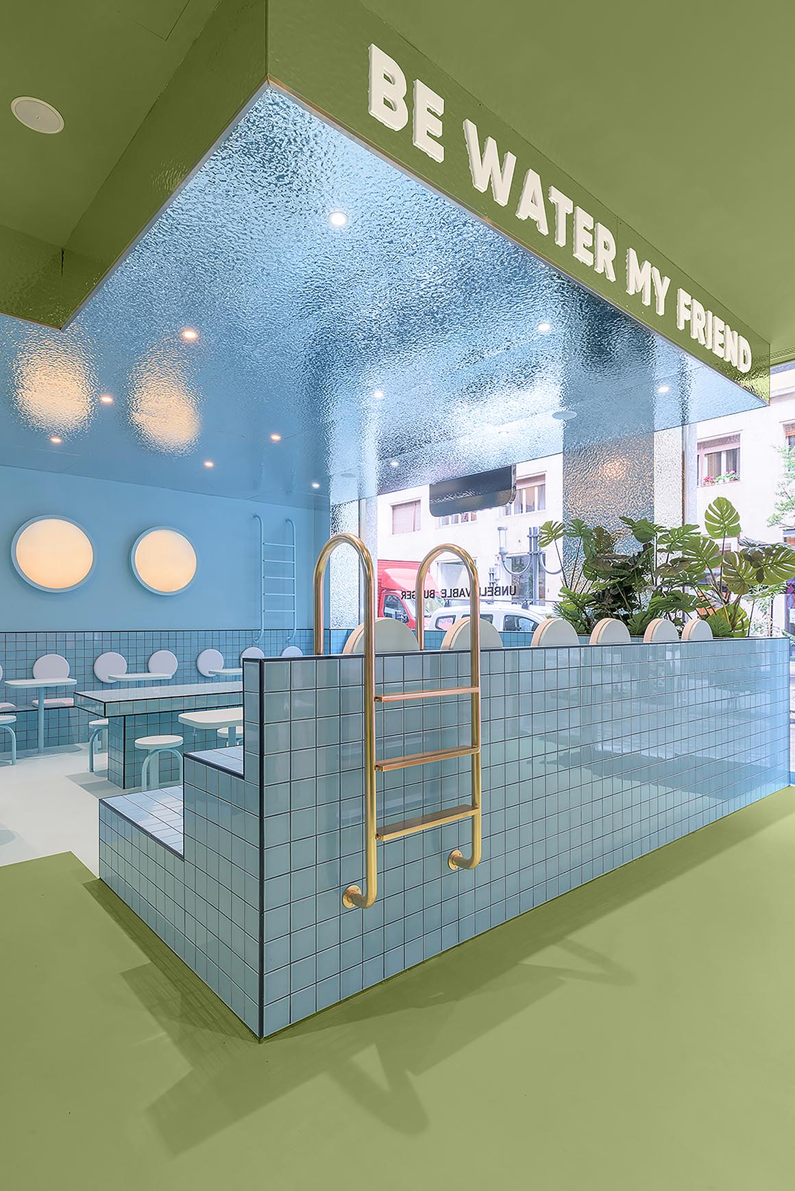 A modern restaurant interior with blue section inspired by a swimming pool.