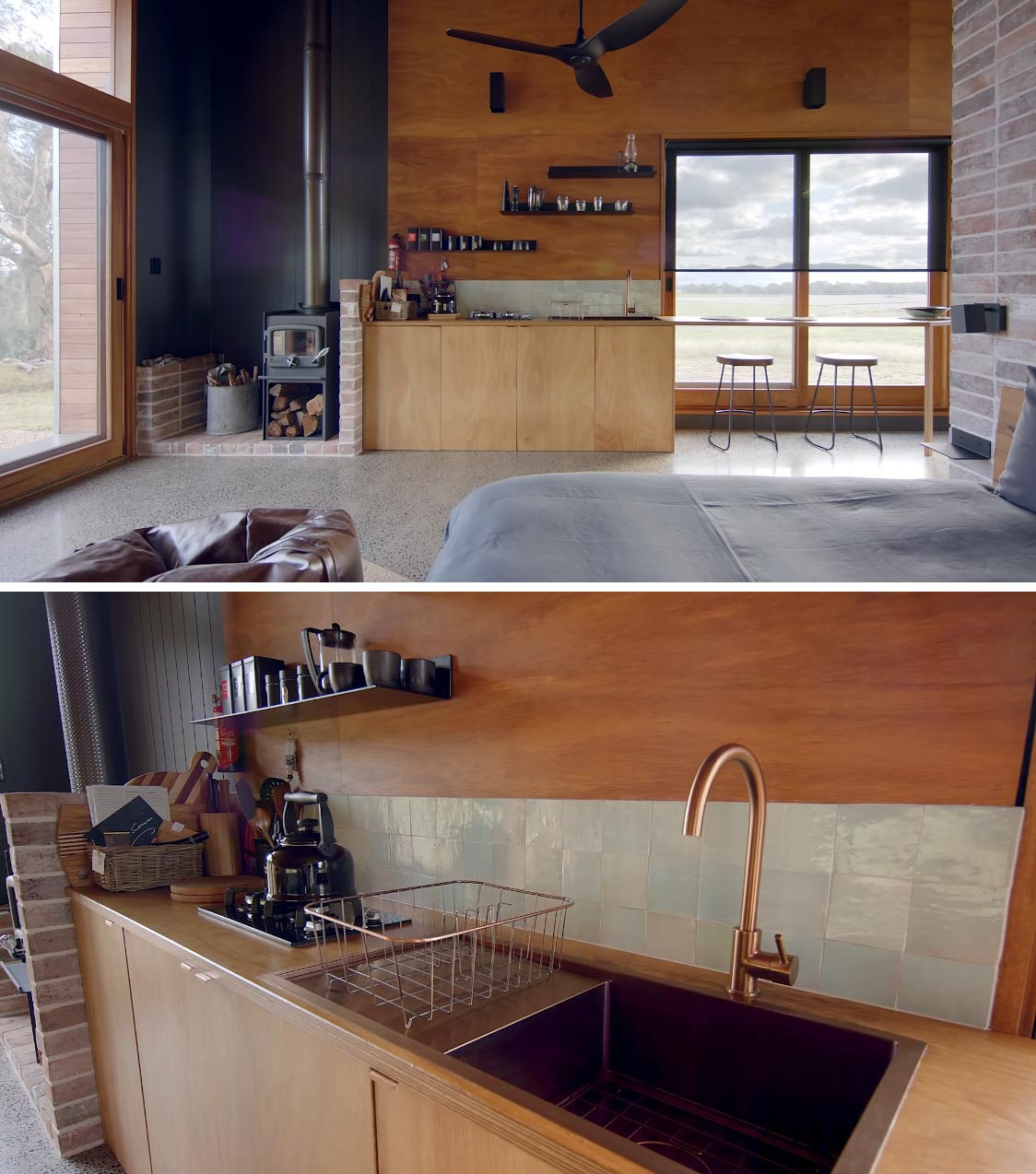 The minimally designed kitchen in this off-grid tiny house includes a wood burning fireplace, a small gas cooktop, sink, small fridge, and floating black shelves.