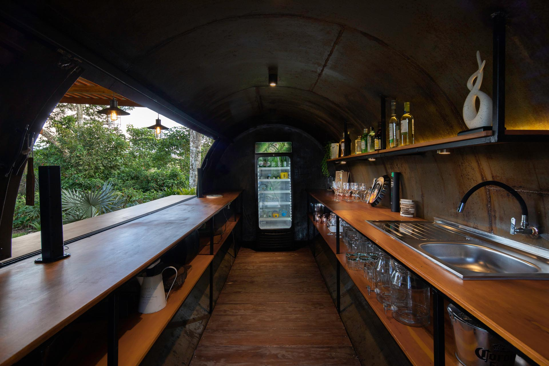 A bar made from a repurposed water tank.