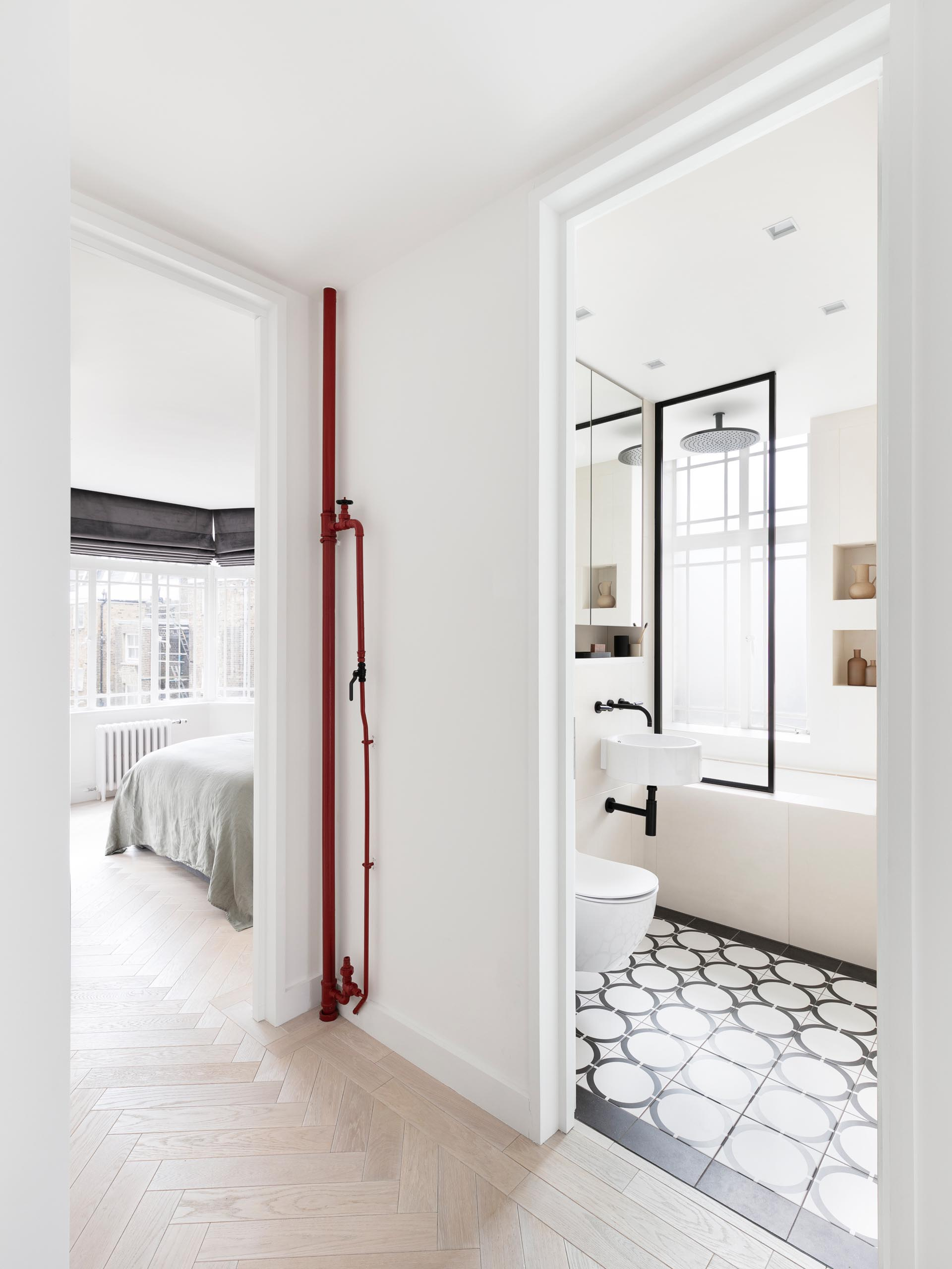 Space saving pocket doors have been installed throughout this modern apartment, like for the bedrooms and bathroom.