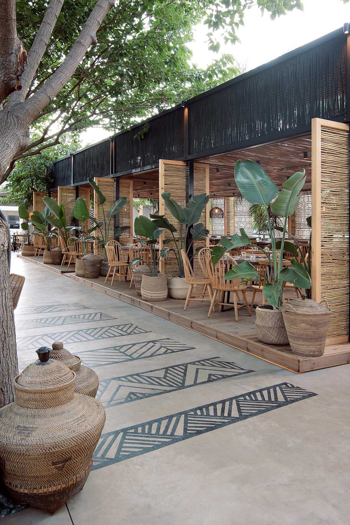 This restaurant and bar has a beach aesthetic that was created with reed screens, lighting, and decor.