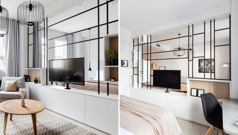 This Black Framed Room Divider Allows The TV To Be Used From Both Sides