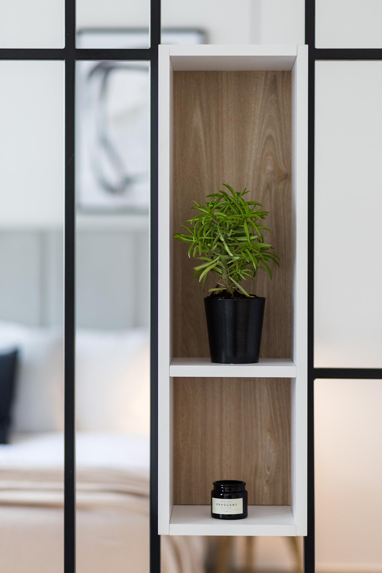 A modern room divider with built-in shelving.