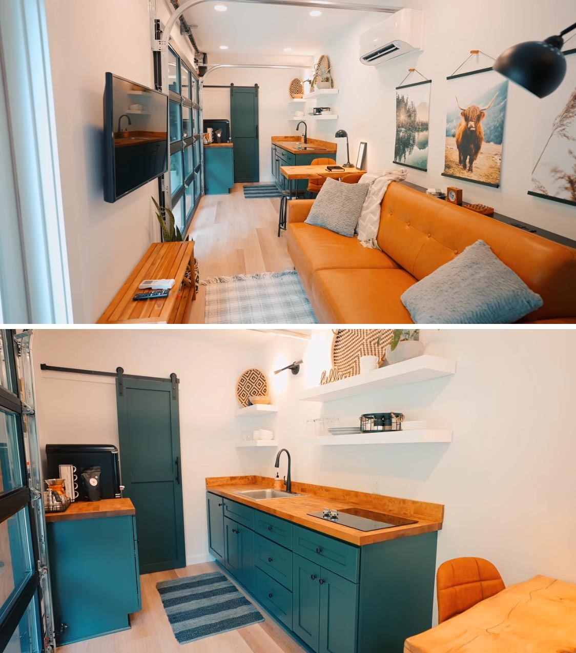 In this modern shipping container home, a small wood table separates the living room from the kitchen, that showcases teal blue cabinets, wood countertops, and white floating shelves that appear to blend into the wall.