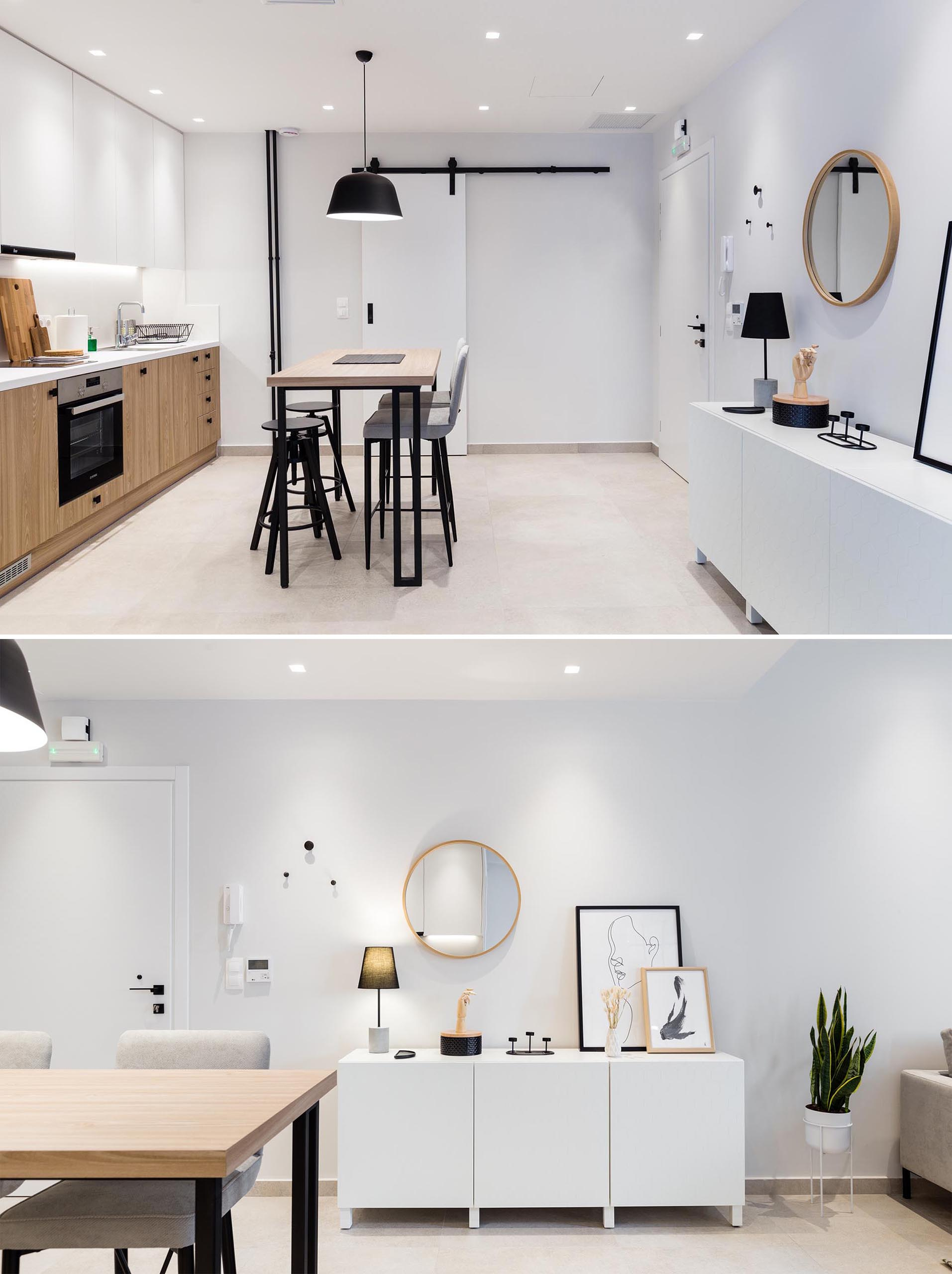 This small and modern apartment has the front door opening directly into the dining area and kitchen. A white sideboard creates added storage for the small apartment.
