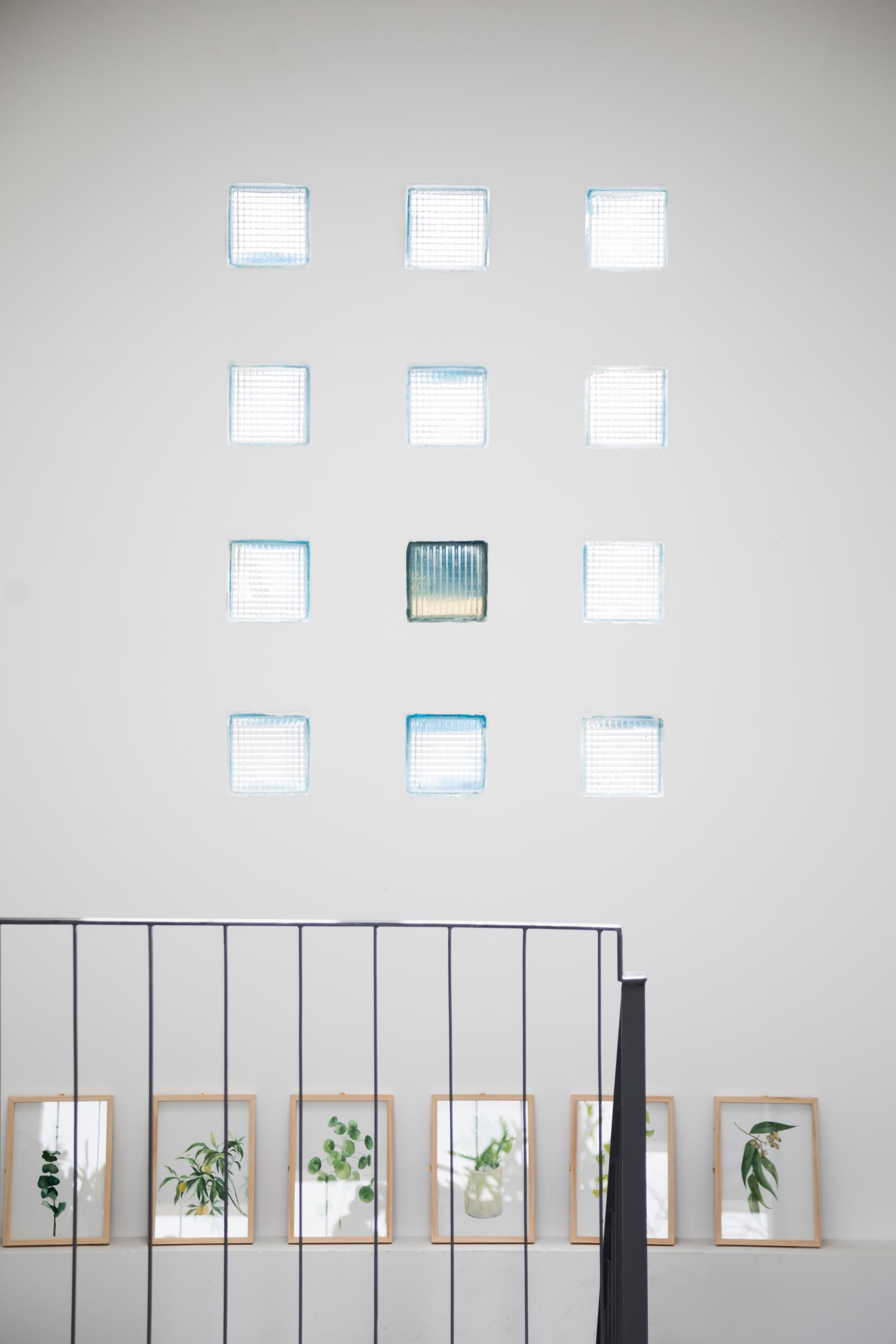 A wall with a grid of small glass block windows.