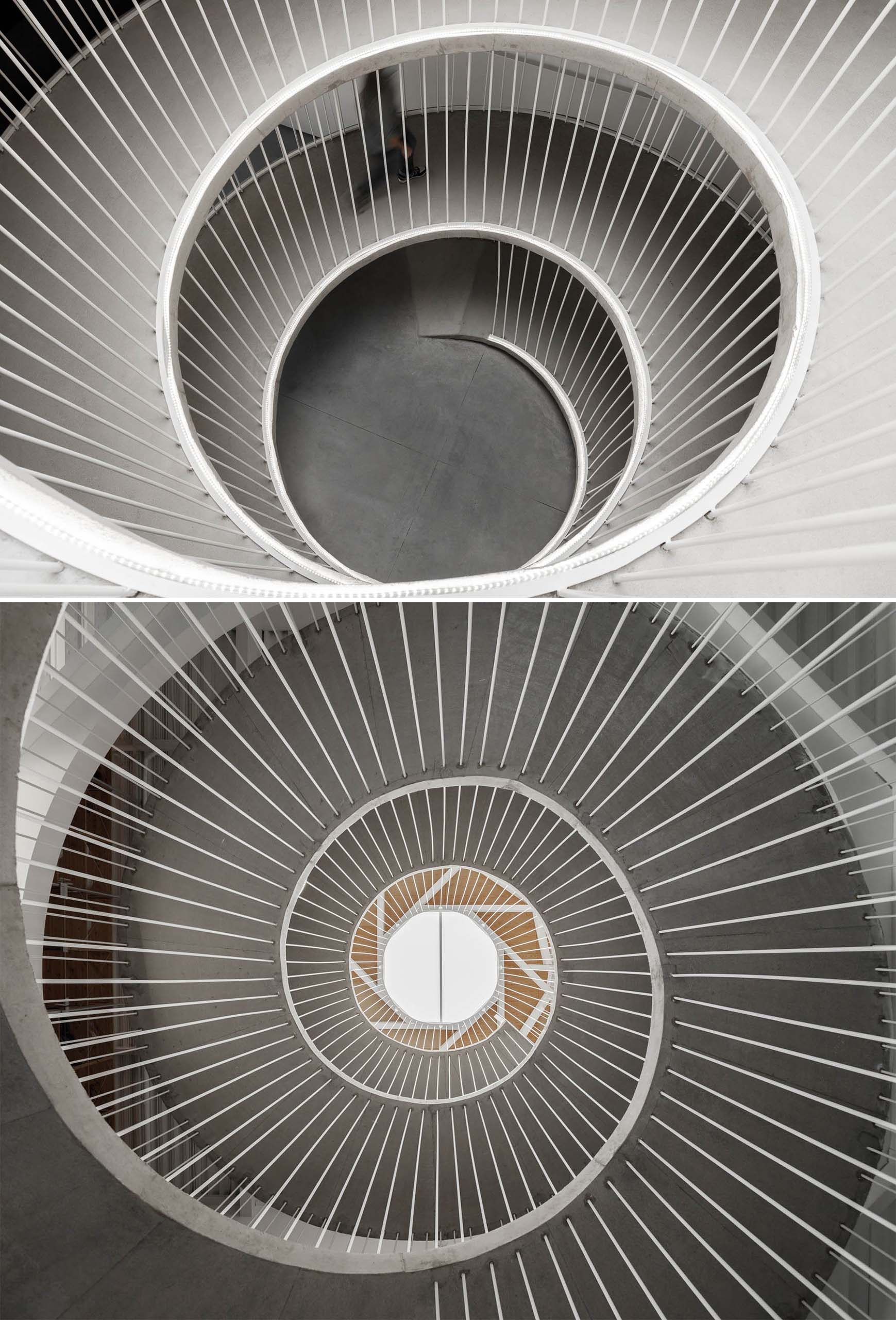 A spiraling ramp replaces the need for stairs in this modern office.