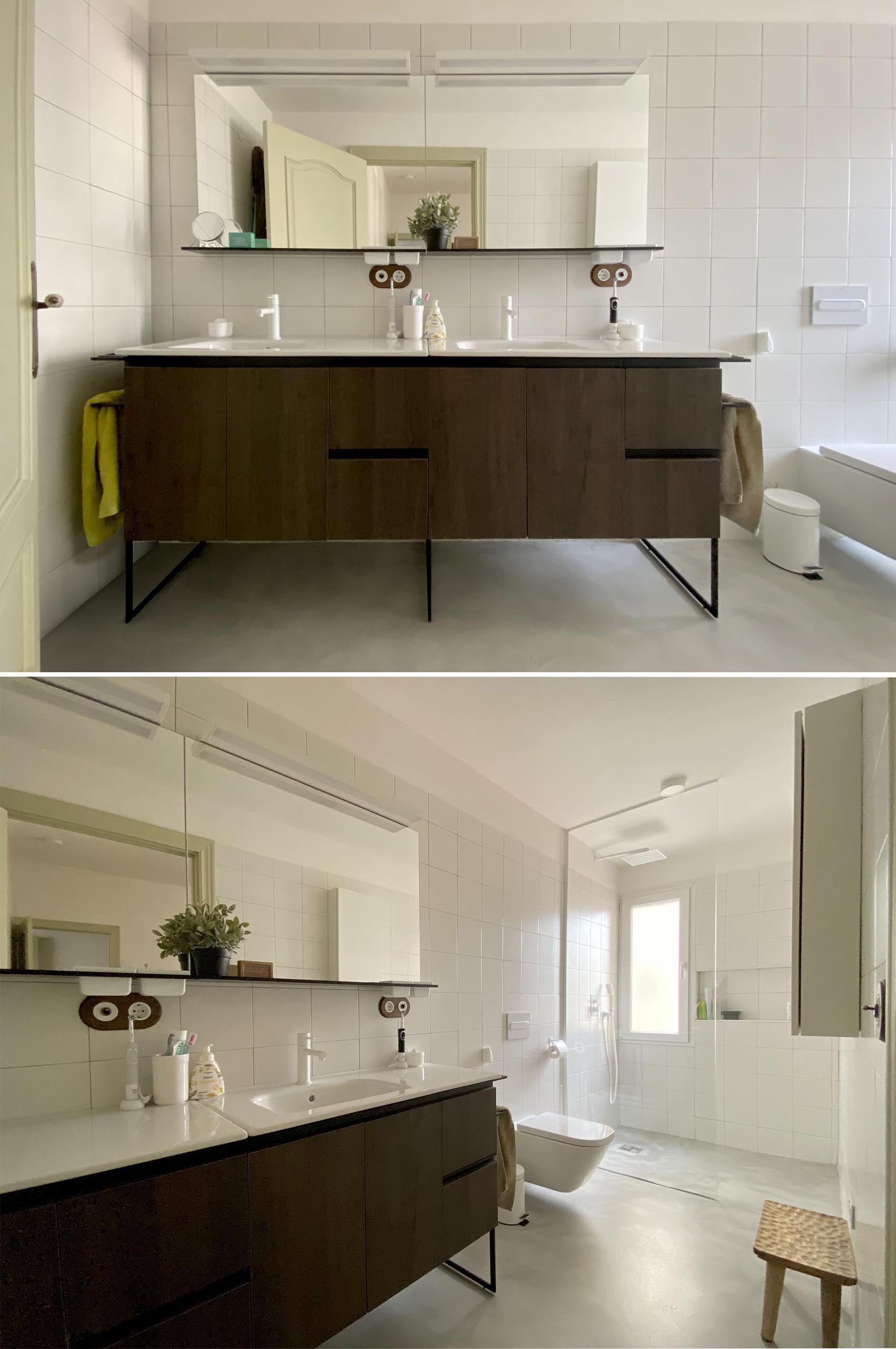 In the bathroom, a dark wood vanity is topped with dual sinks, while square white tiles cover the walls and shower.