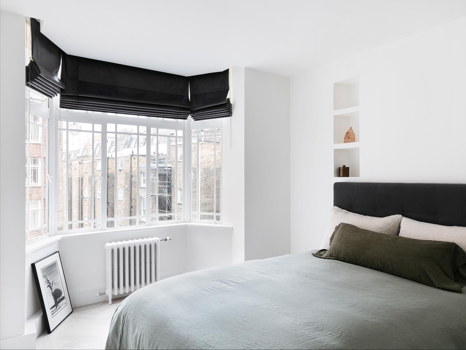 In this remodeled bedroom, the designers opened-up hidden wall niches and lowered the ceilings to hide curtain tracks.