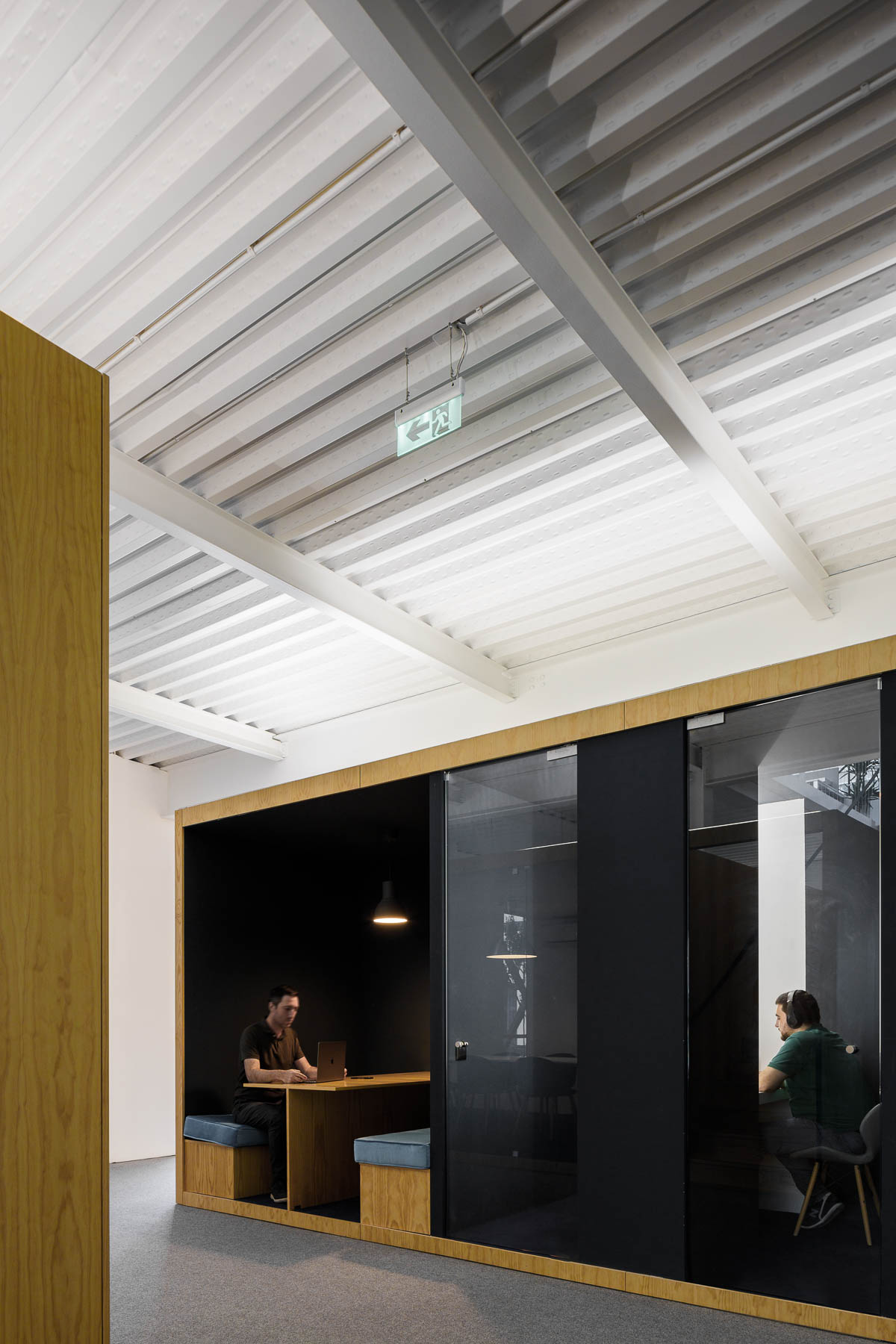 A modern office interior with a variety of work areas.