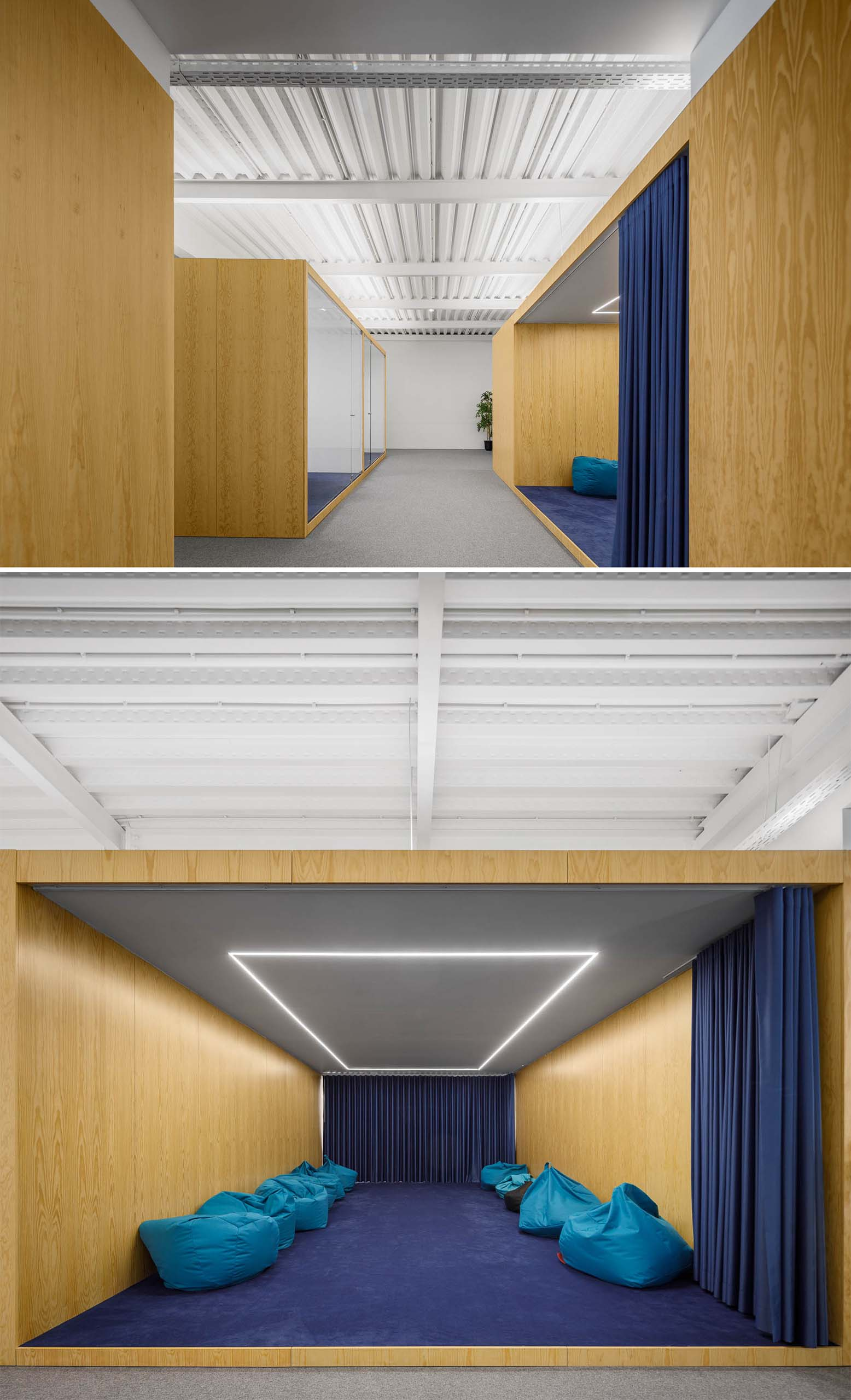 A large meeting room with a blue curtain that's filled with beanbags and has LED lighting in the ceiling.