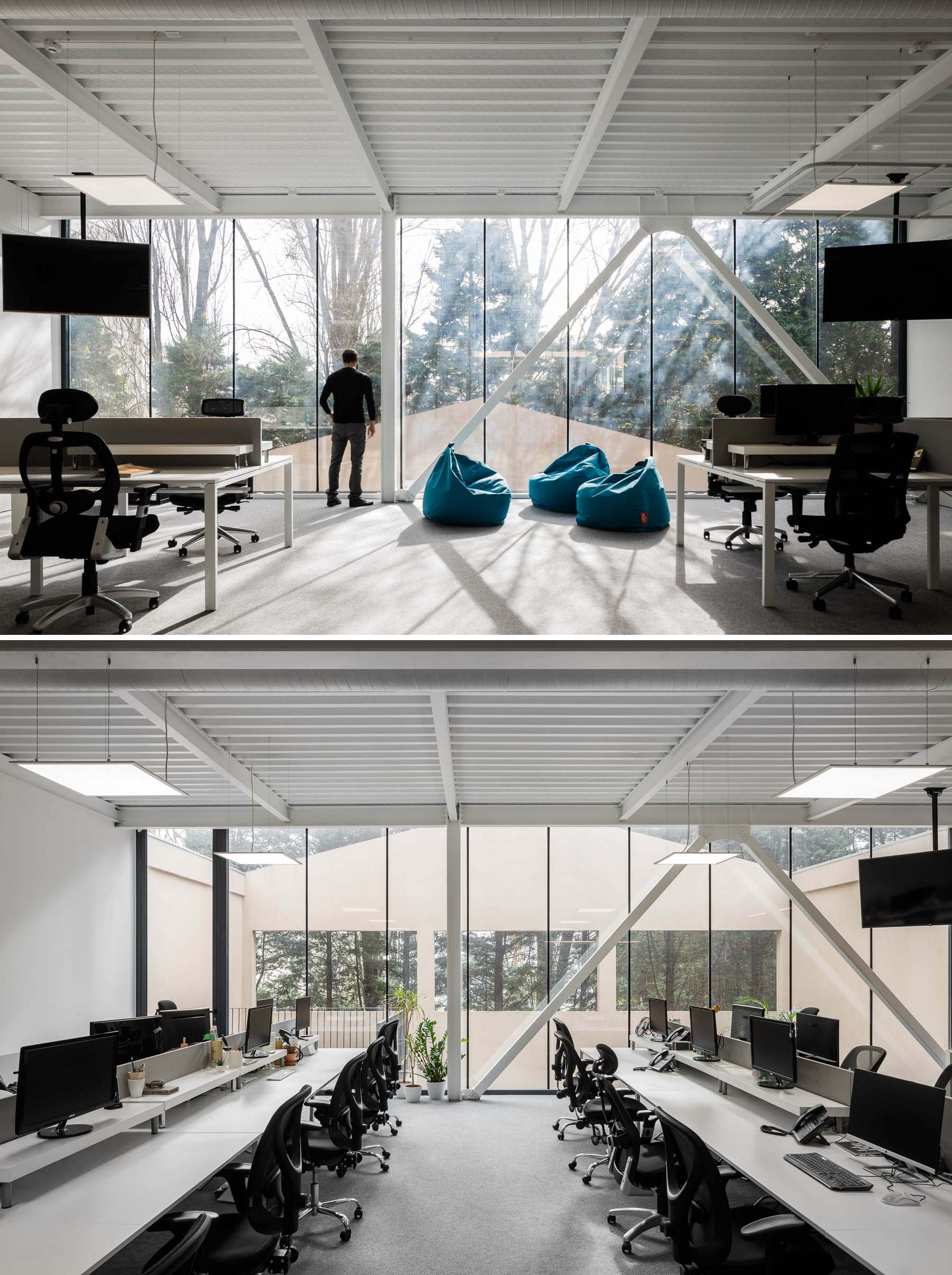 A modern office with floor-to-ceiling windows.