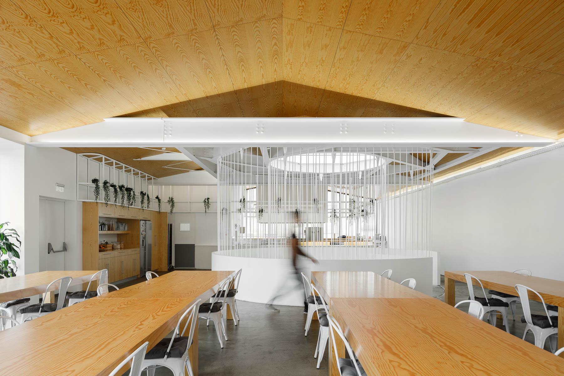 A modern office with a communal break room.