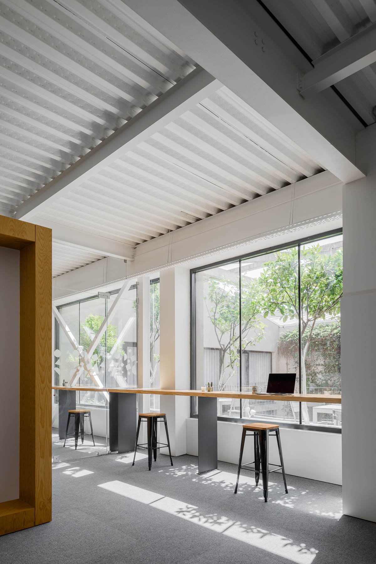 A modern office with seating by the windows that take advantage of the natural light.