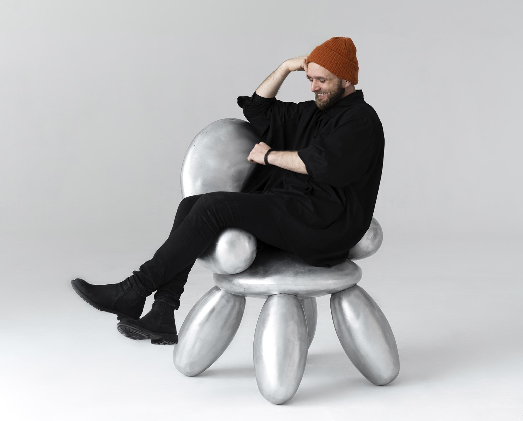 A metallic chair with a bubble appearance.