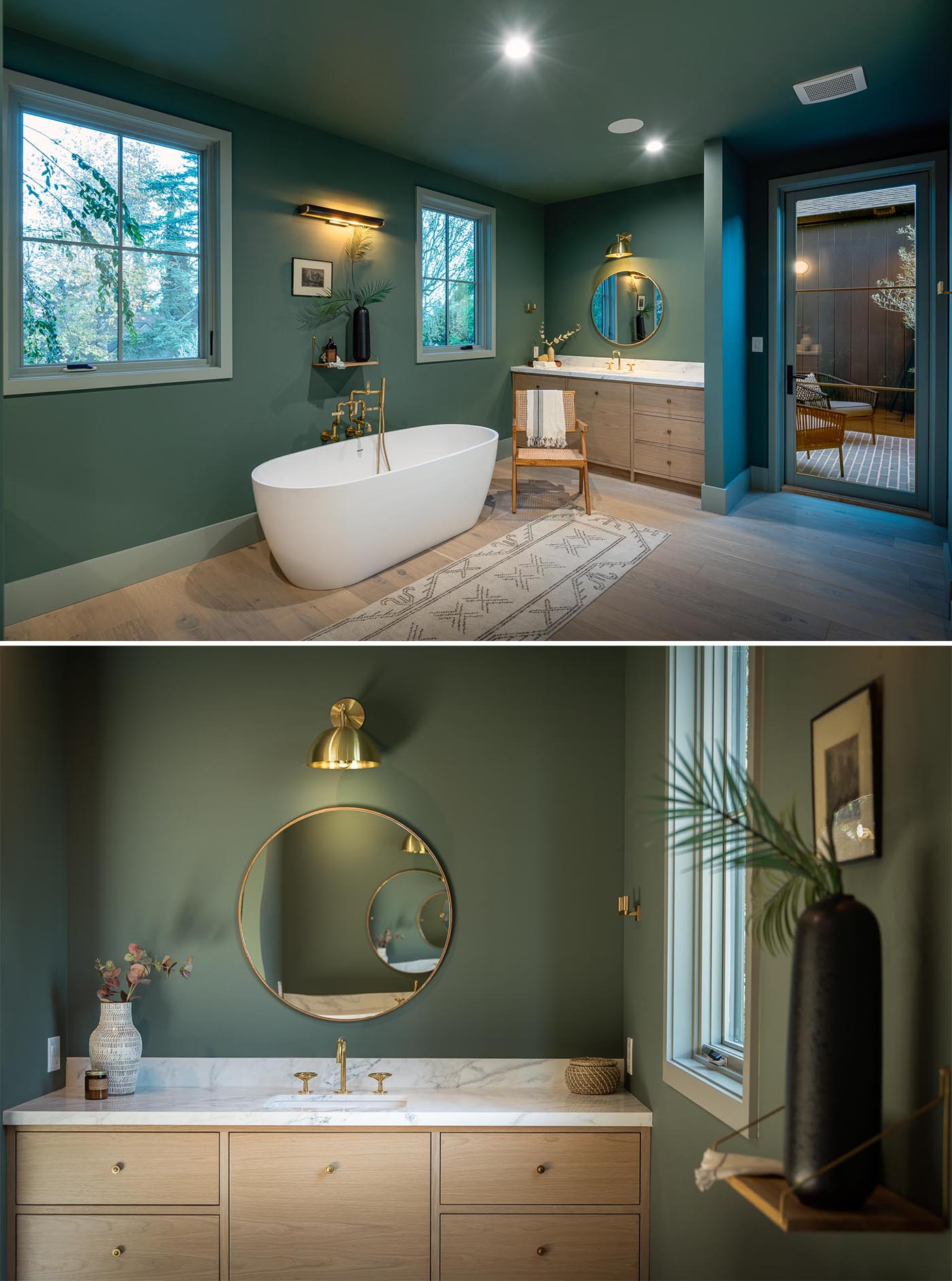 This modern bathroom showcases Elan Vital exposed aged brass plumbing, a freestanding bathtub, and honed marble counters topping the wood vanities.