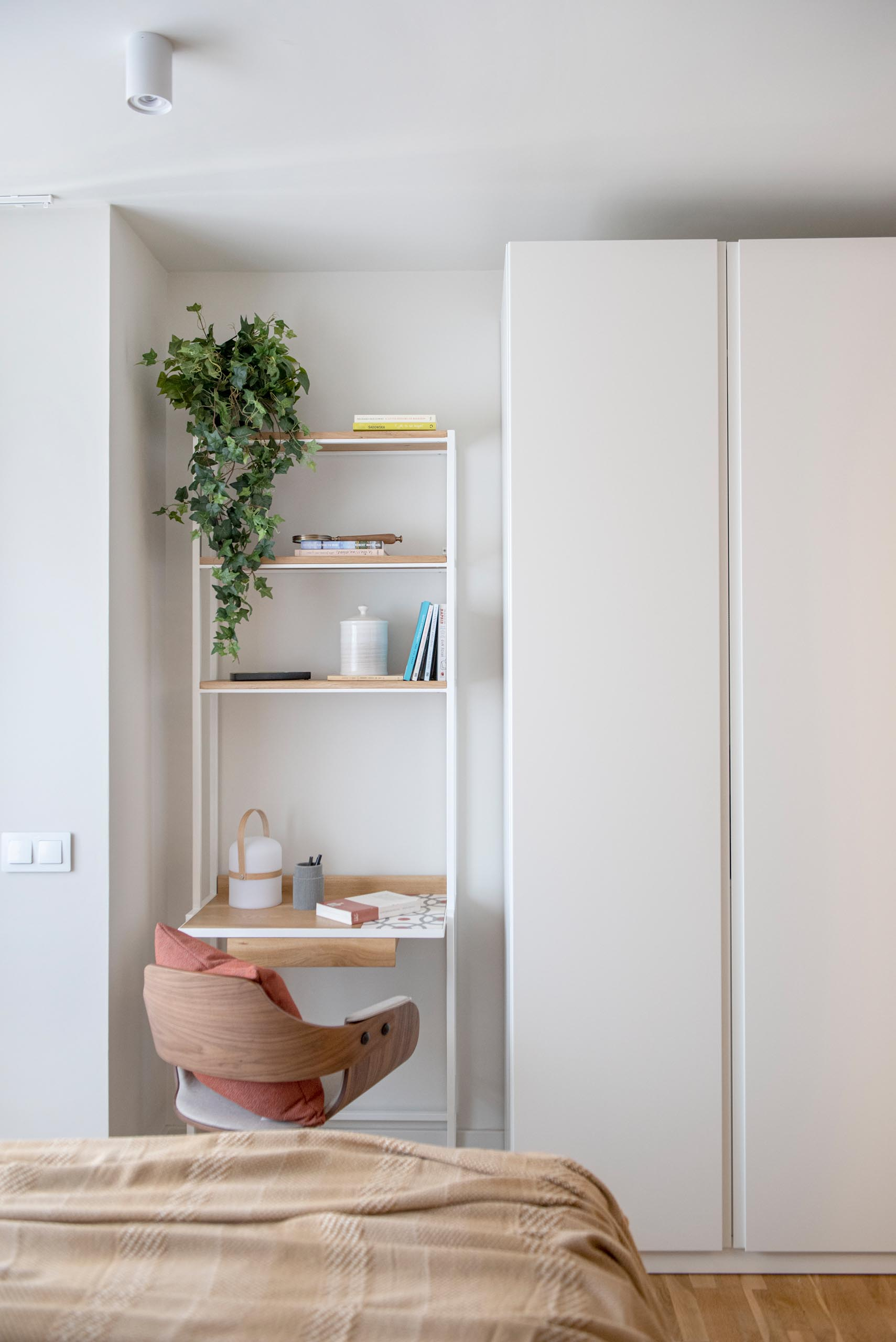 A modern bedroom with a small desk area.