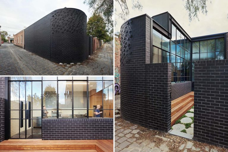 Black Brick Walls Wrap Around The New Addition To This Home