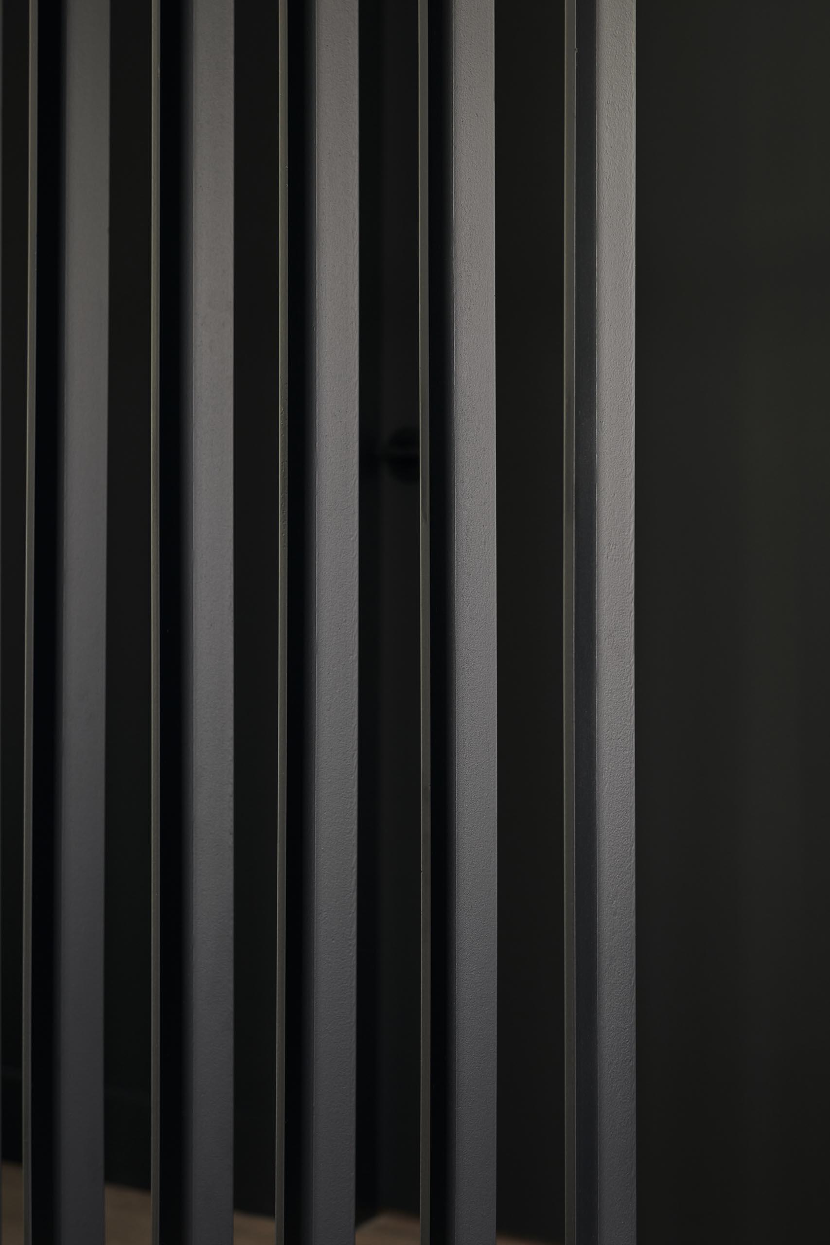 A closeup view of a room divider.