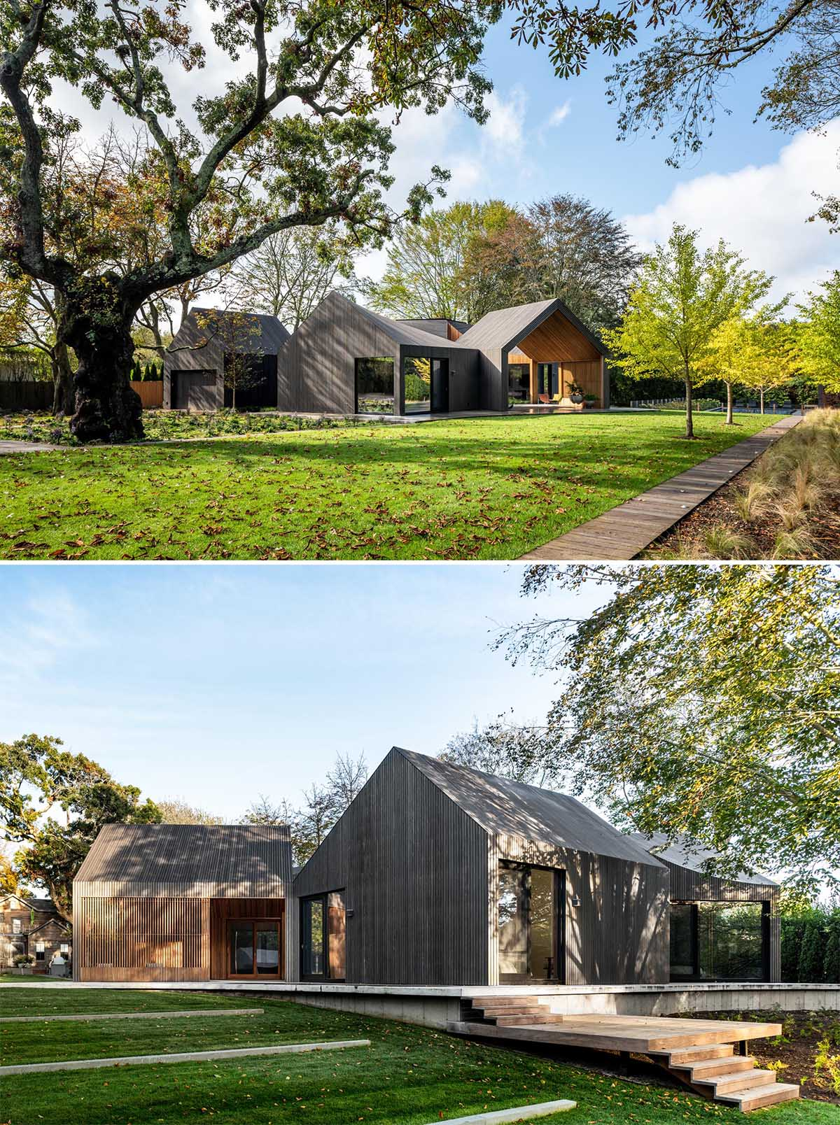 A modern house with six modules, is clad in charred, stained, and sealed accoya wood siding.