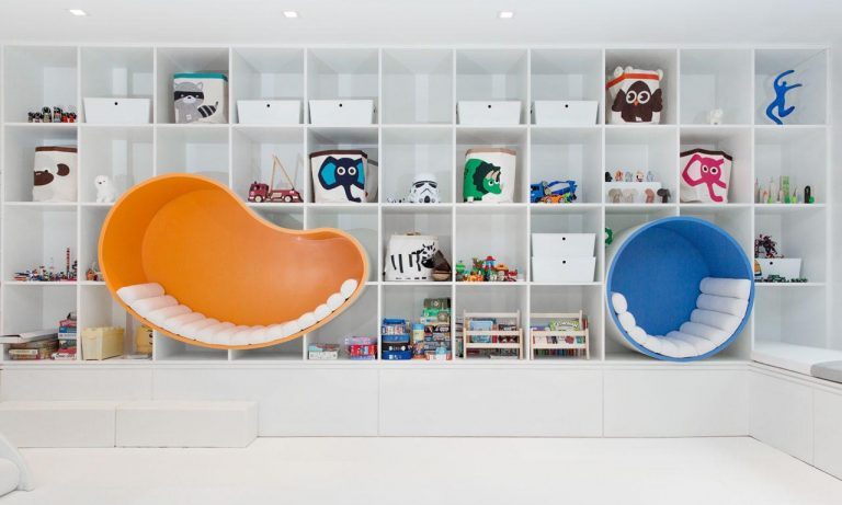 Seating Nooks Were Built Into A Wall Of Shelving In This Kid's Playroom