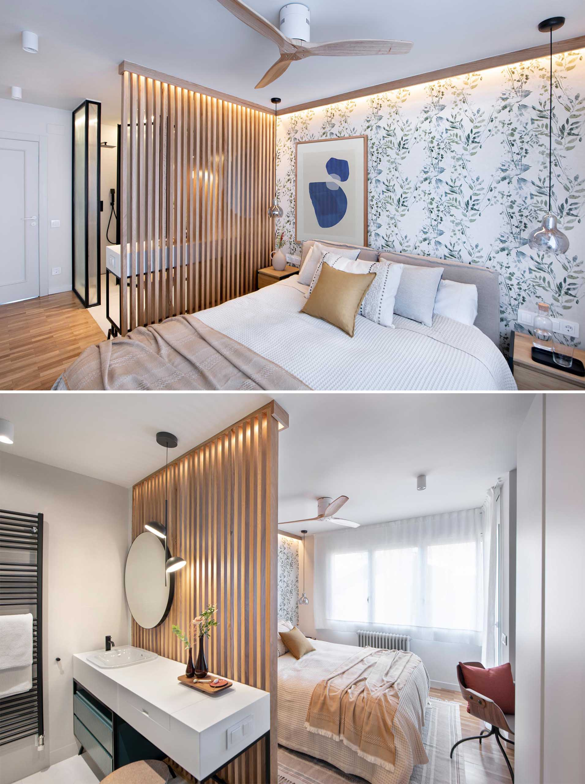 A modern primary bedroom and en-suite bathroom. Botanical wallpaper creates a feature wall, while the wood slat accent wall provides separation between the sleeping area and the bathroom.
