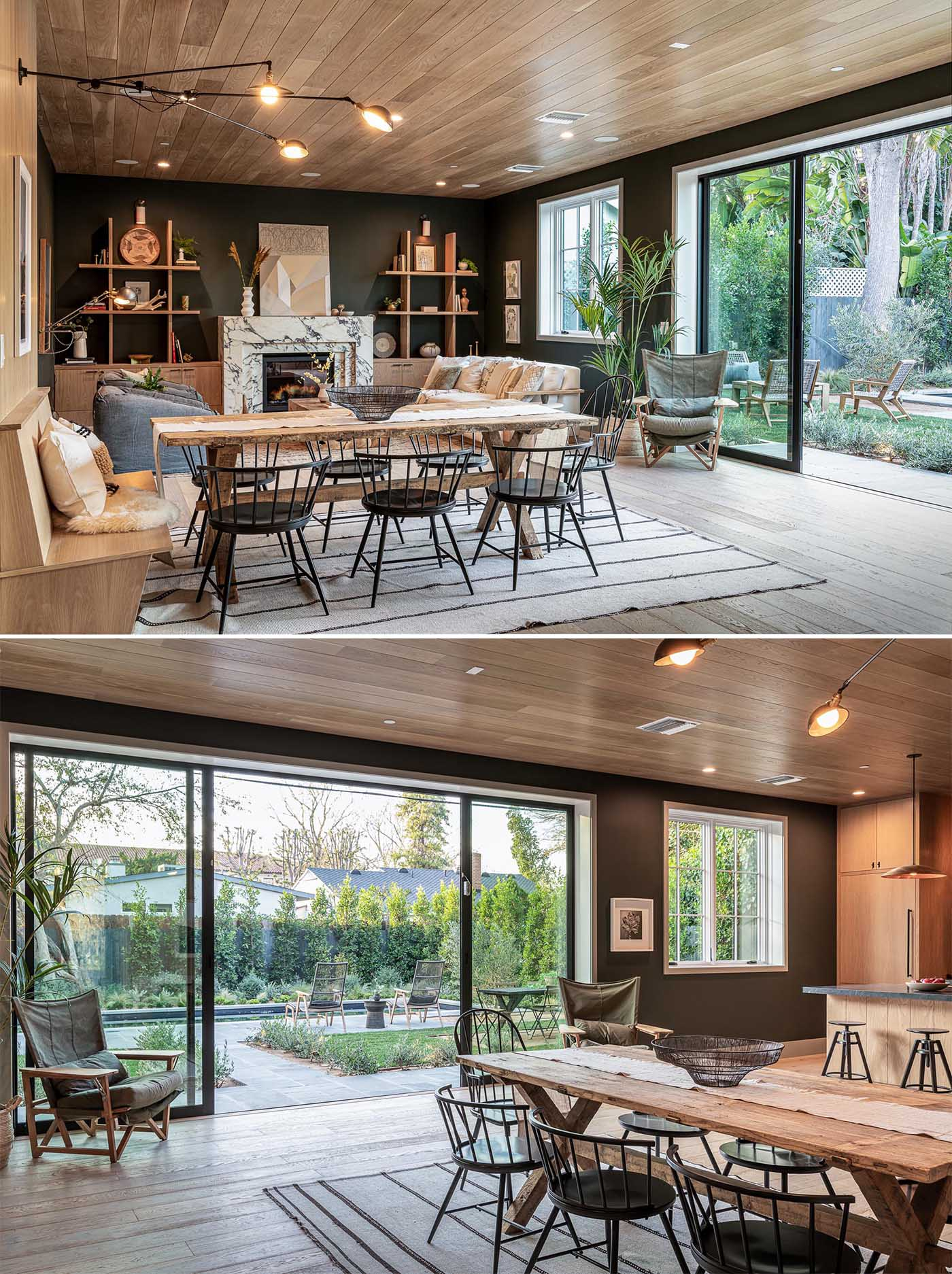 This dining area, with a wood bench at one end, separates the living room from the kitchen. Large sliding glass doors open the interior space to the yard.
