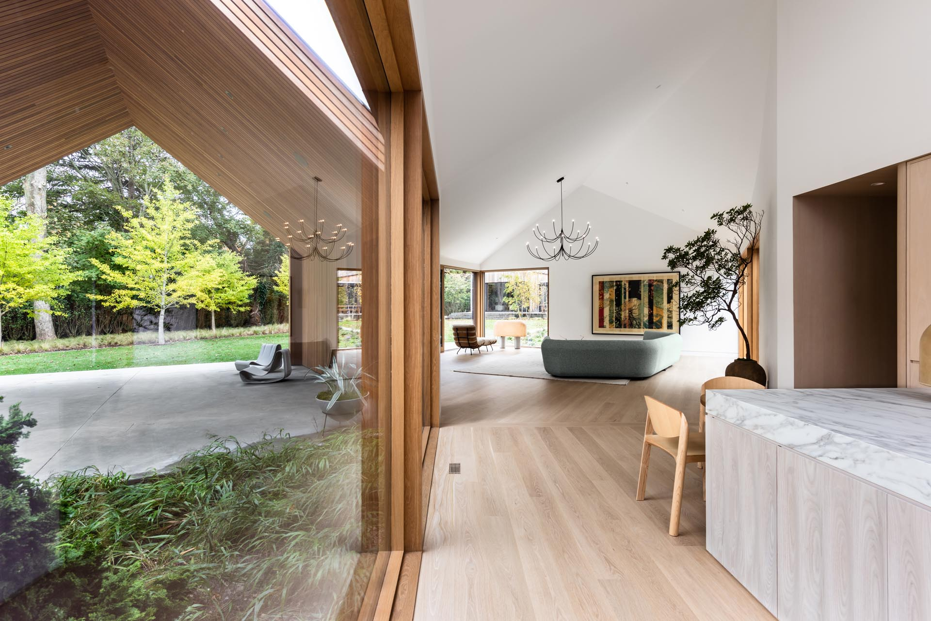 White oak wood floors add a sense of warmth to this modern home interior.