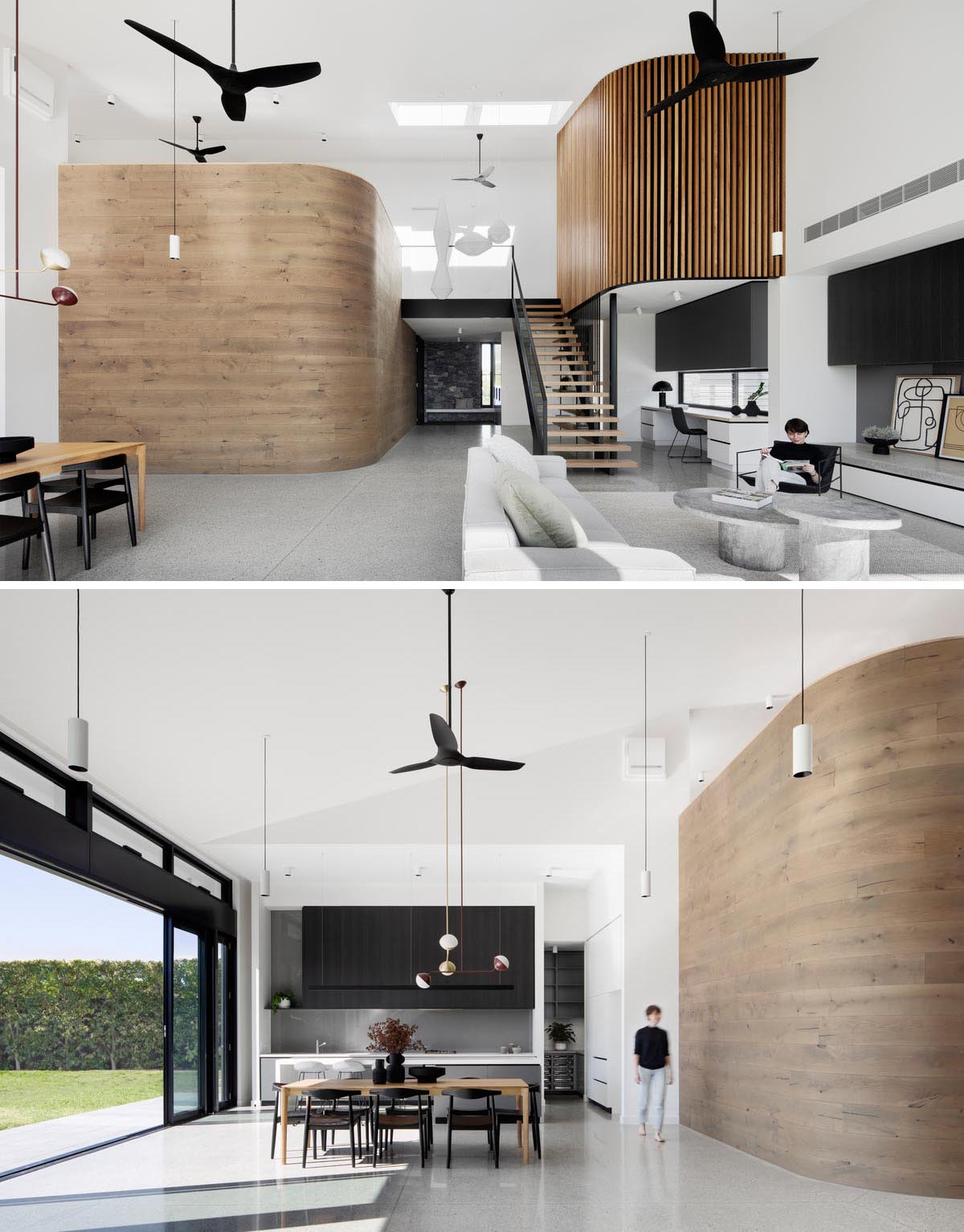 A modern interior with a curved timber wall and a second wood wall clad in timer battens.
