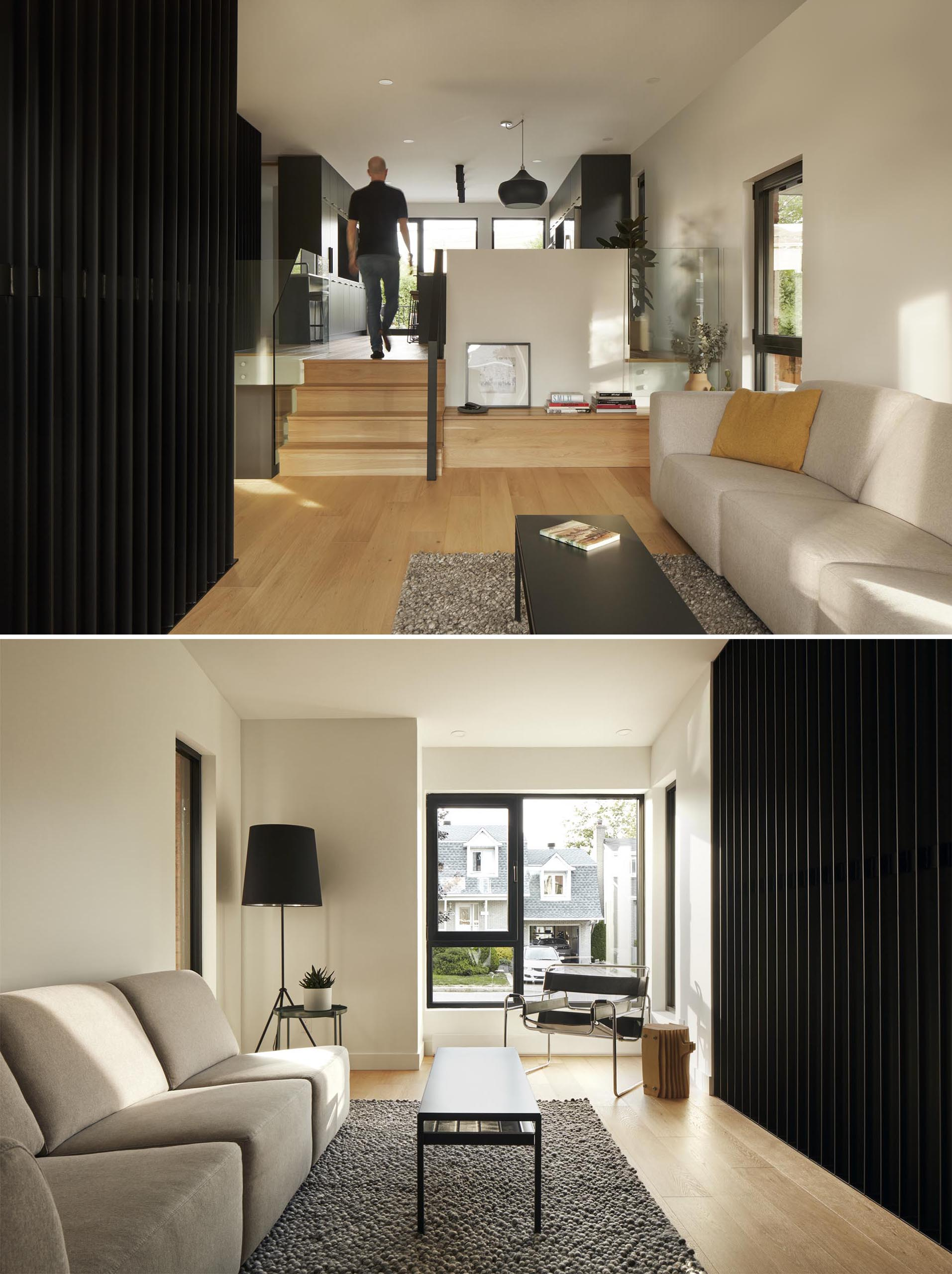 This modern living room has contemporary furnishings, and a view of the entryway and the street.