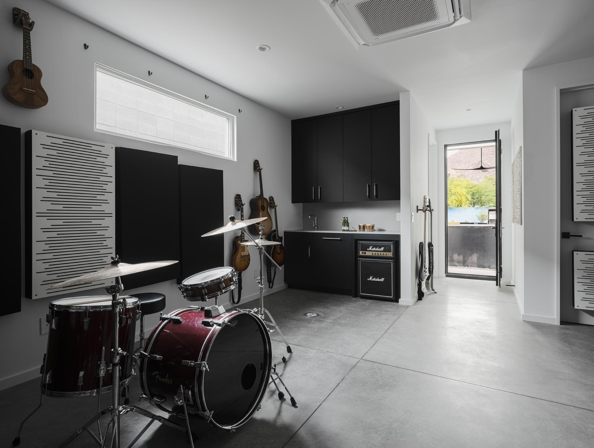 A detached 500 square foot music studio provides a place to play and record music, and there's a hidden roof deck on top for views of the valley.