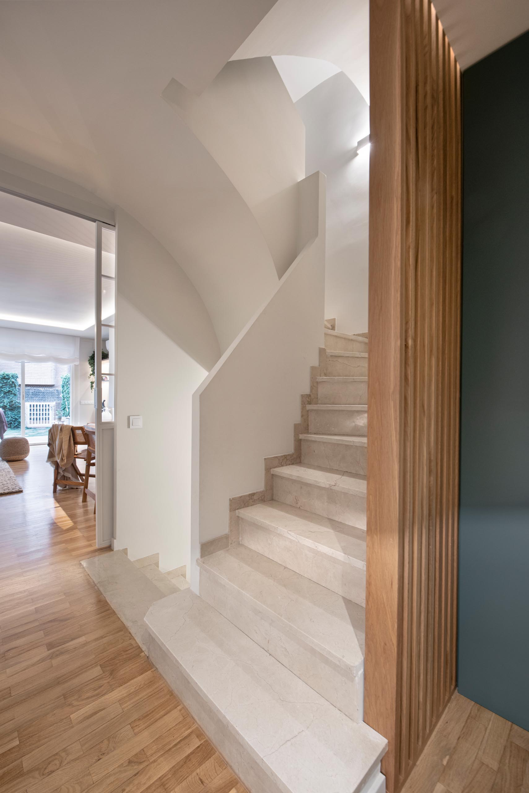 A semi-open staircase connects the various levels of this modern home.