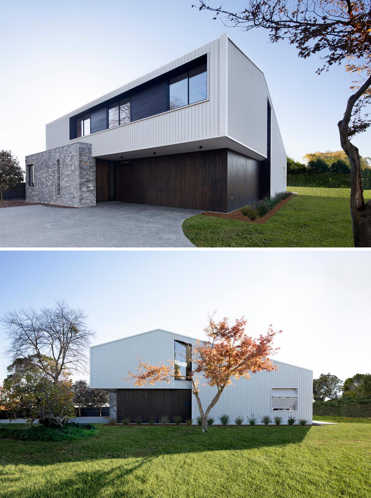 The exterior of this modern home features metal cladding with a white finish, black window frames, dark wood accents, and drystone stacked walls.