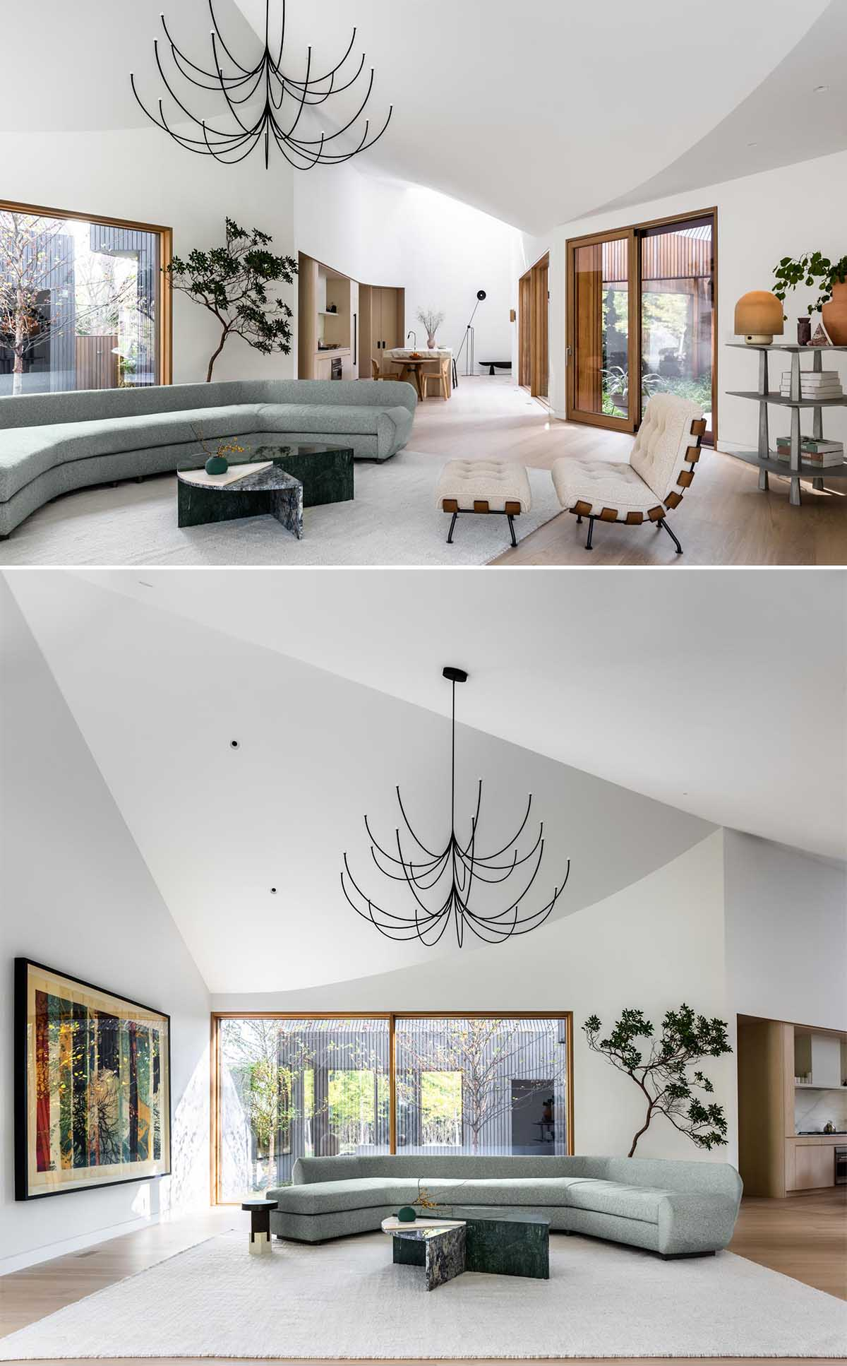 A bright white interior contrasts the exterior of the home, and creates a feeling of openness, which is also accentuated by the angled ceilings, that can be found in both the living room and kitchen.