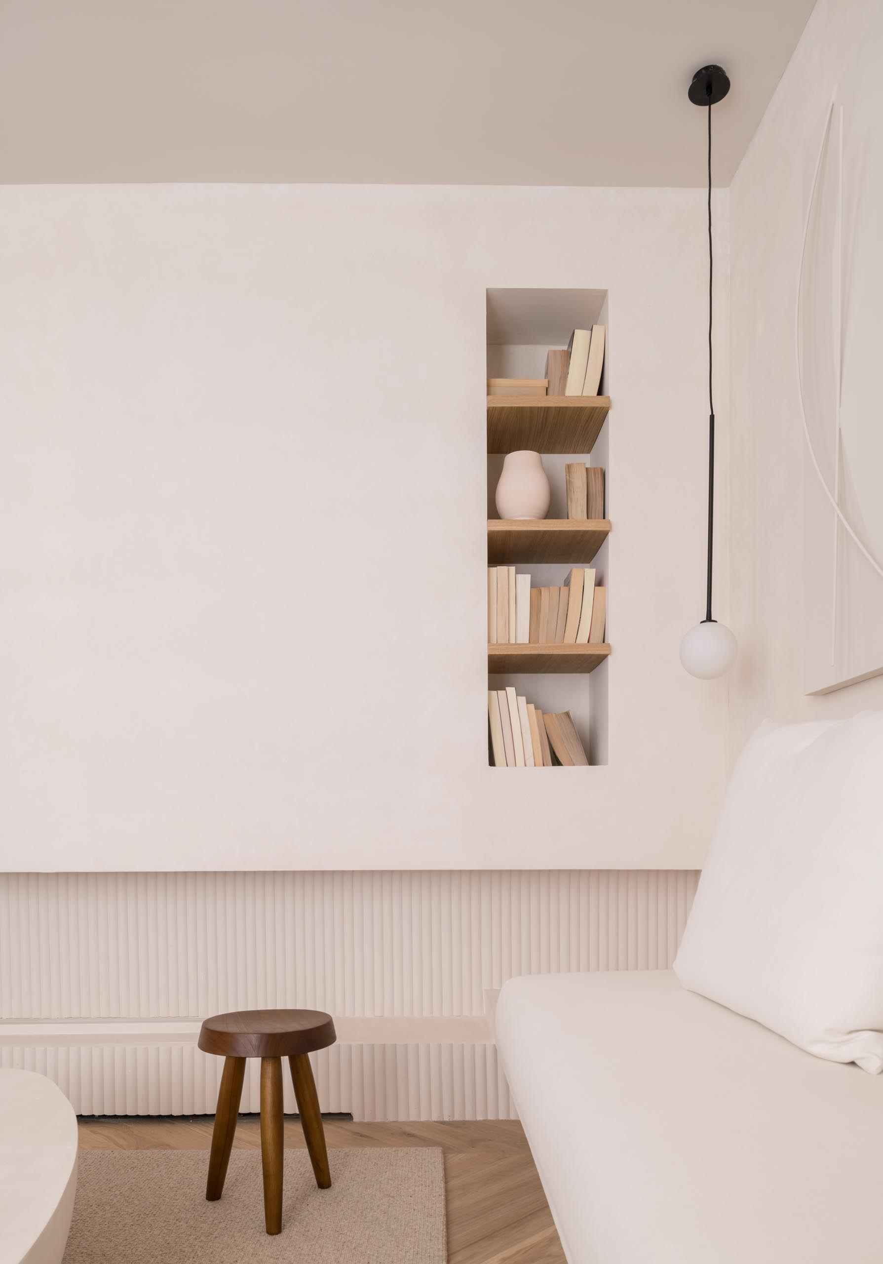A built-in bookshelf with wood shelves.