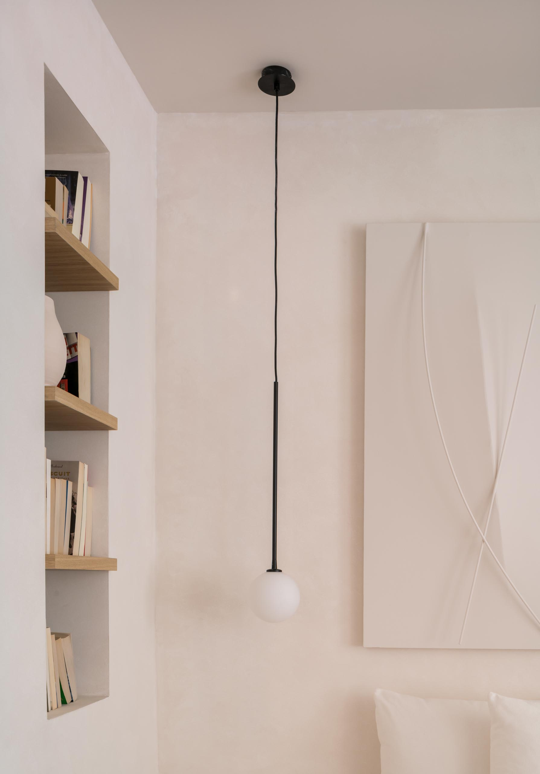 A recessed nook with built-in wood shelves.