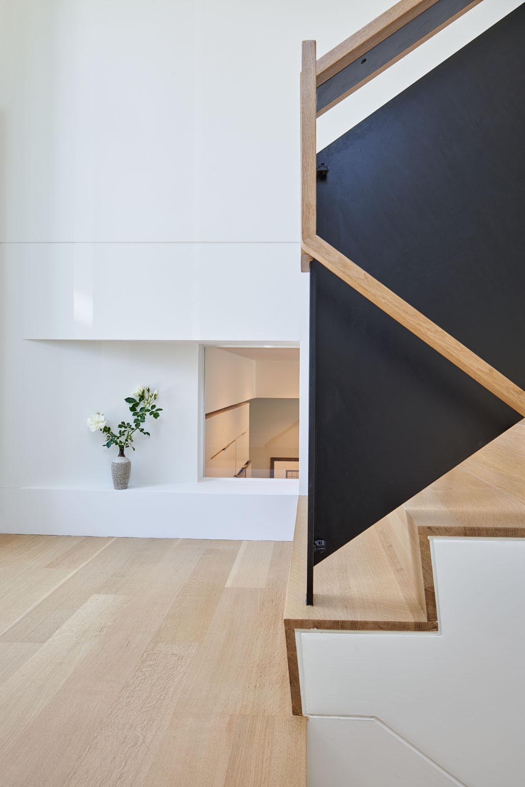 The wood stairs of a modern split-level home.