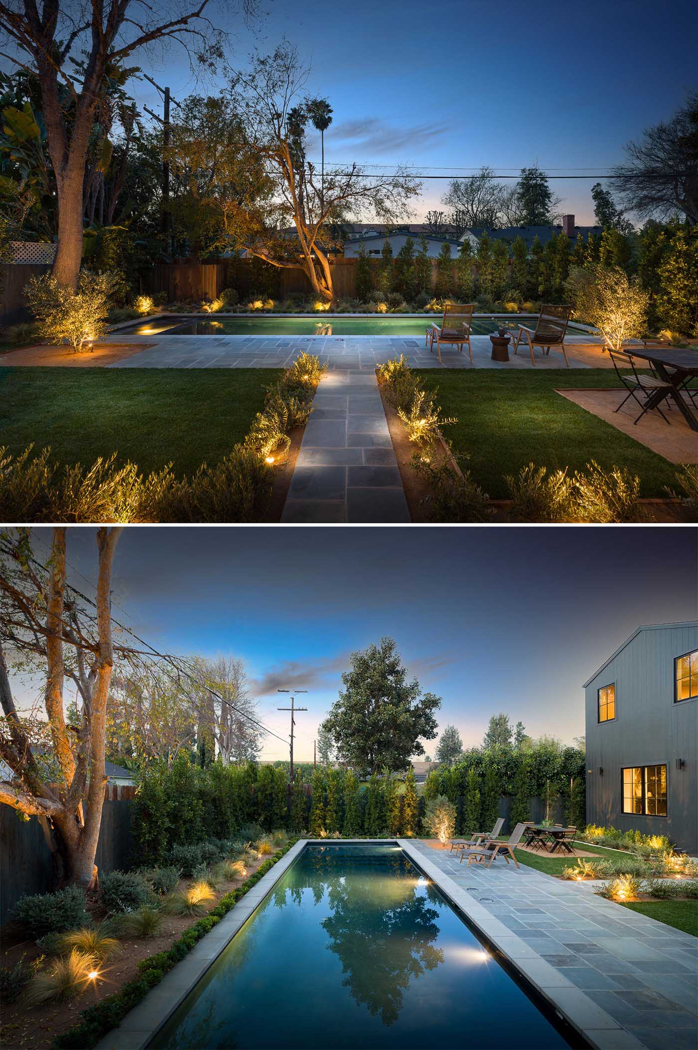 A landscaped backyard with a 50 foot swimming pool.