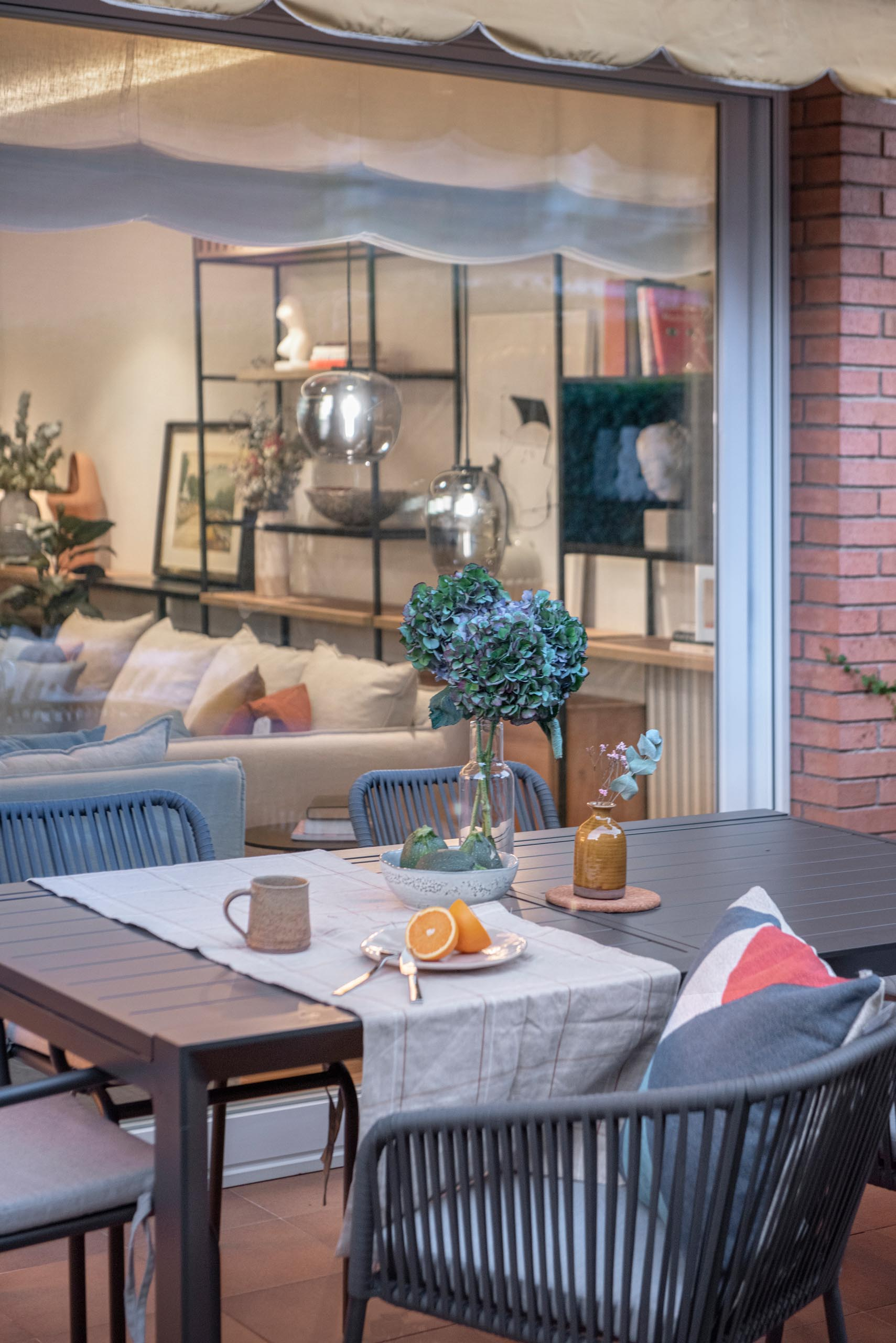 This garden terrace is furnished with an outdoor lounge and an alfresco dining area.