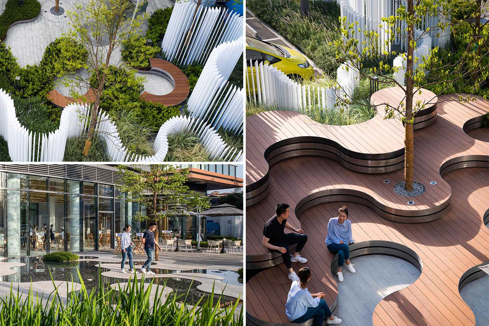 A landscaped park that includes curved tiered seating, water features, a vertical white strip fence, and outdoor lighting.