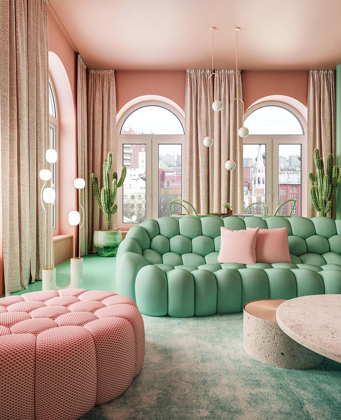 A pink and green living room with floor-to-ceiling curtains and an open floor plan.