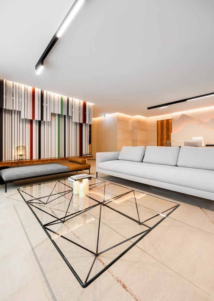 This apartment building common room has been designed with modern furnishings, which provide spaces to meet and mingle with other residents.