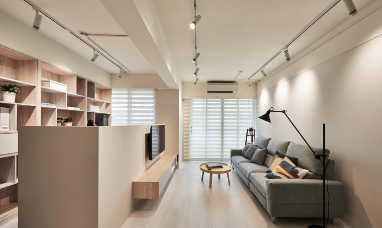 A Partition In The Living Room Creates Space For A Home Office In This Apartment