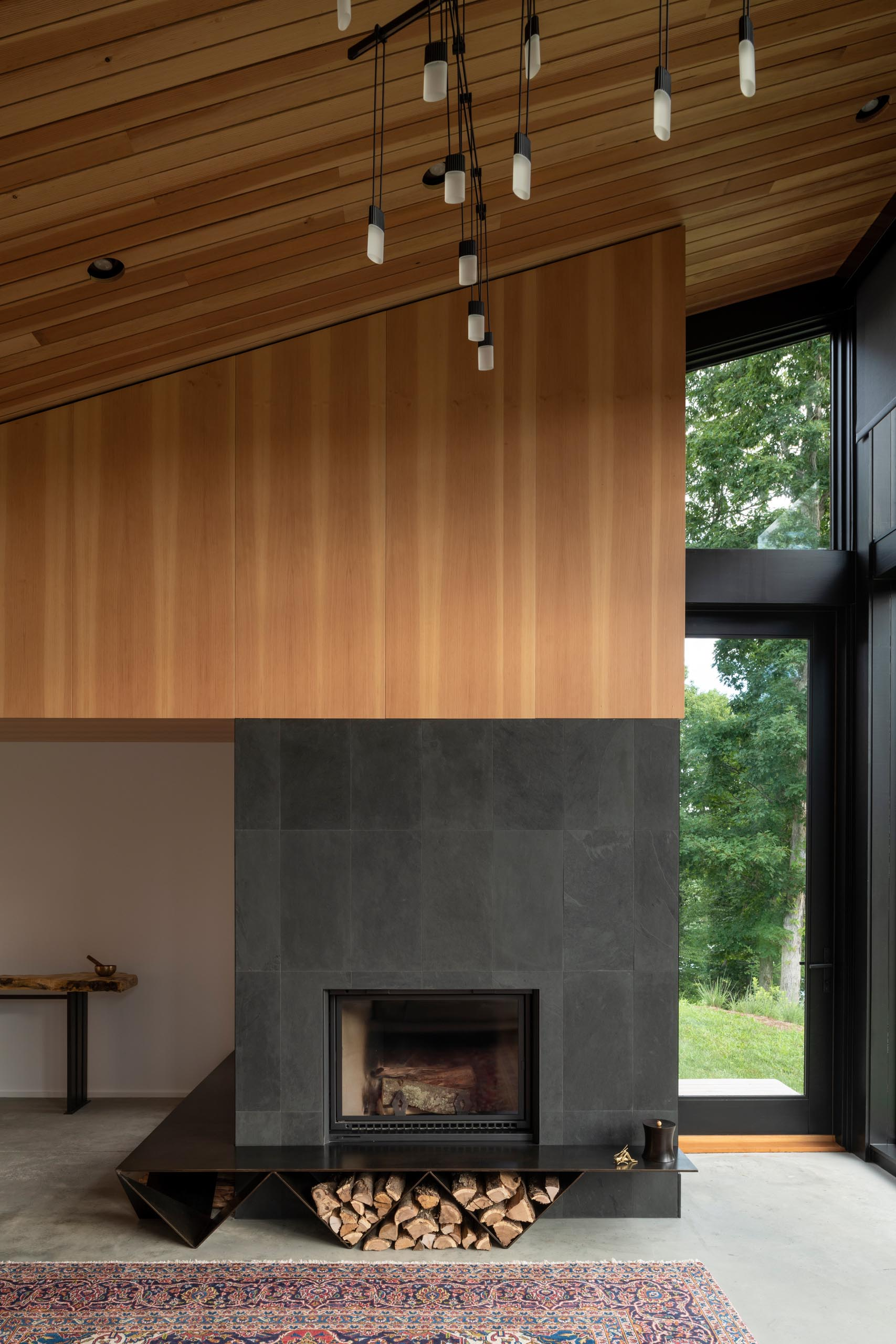 A modern fireplace with a charcoal surround and black fireplace.